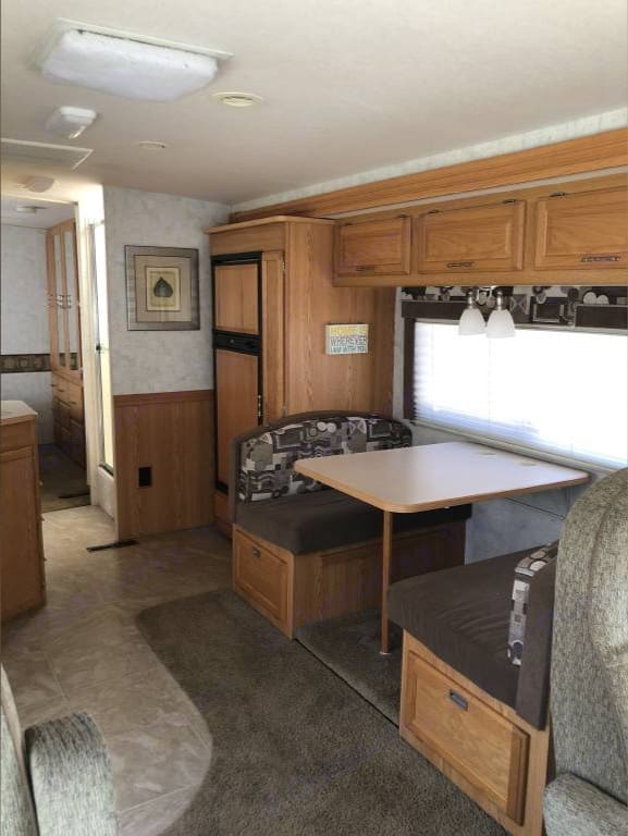 Dinette which converts to bed with slideout.. Winnebago Sightseer 2006