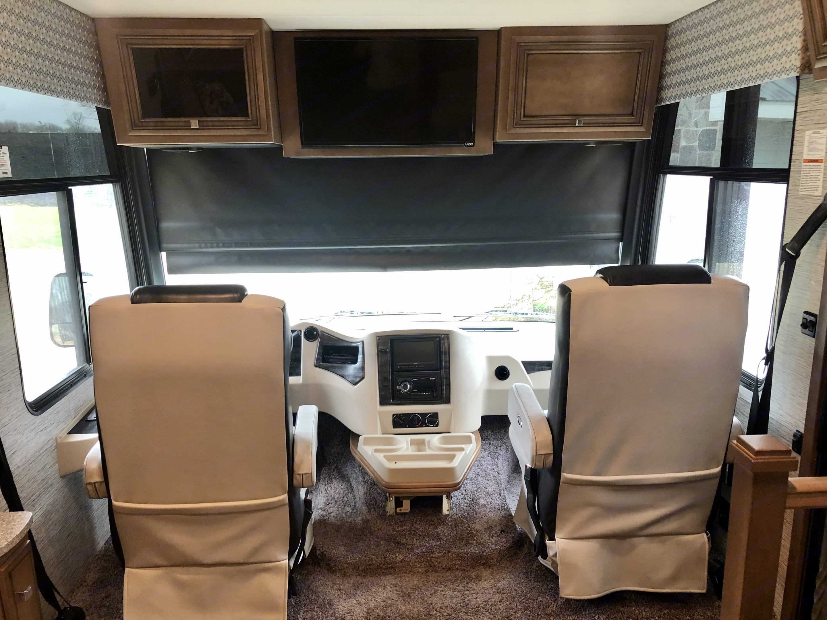Blackout shades all around for privacy and sun filtering shades for letting light in. Also a TV for movie watching when parked. . Newmar Bay Star 2019