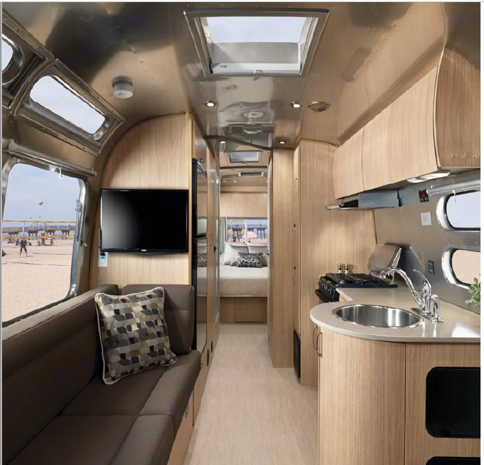 View looking from Dinette back to the master bedroom in front of trailer. Kitchen on Right and sofa on left. Airstream Flying Cloud 25ft 2020