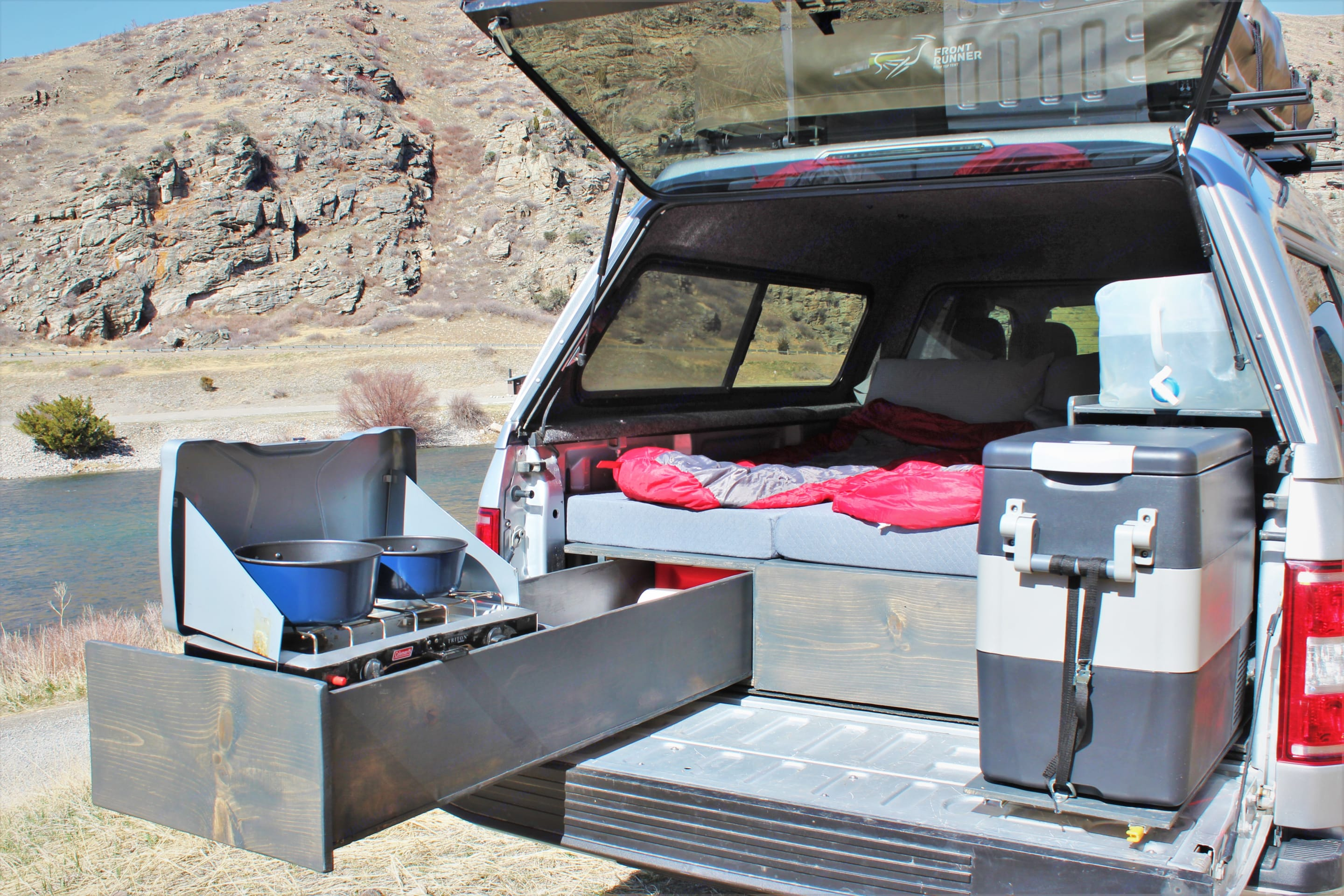 Slide out fridge and kitchen with all the camp utensils you will need . Ford Ford F150 2018