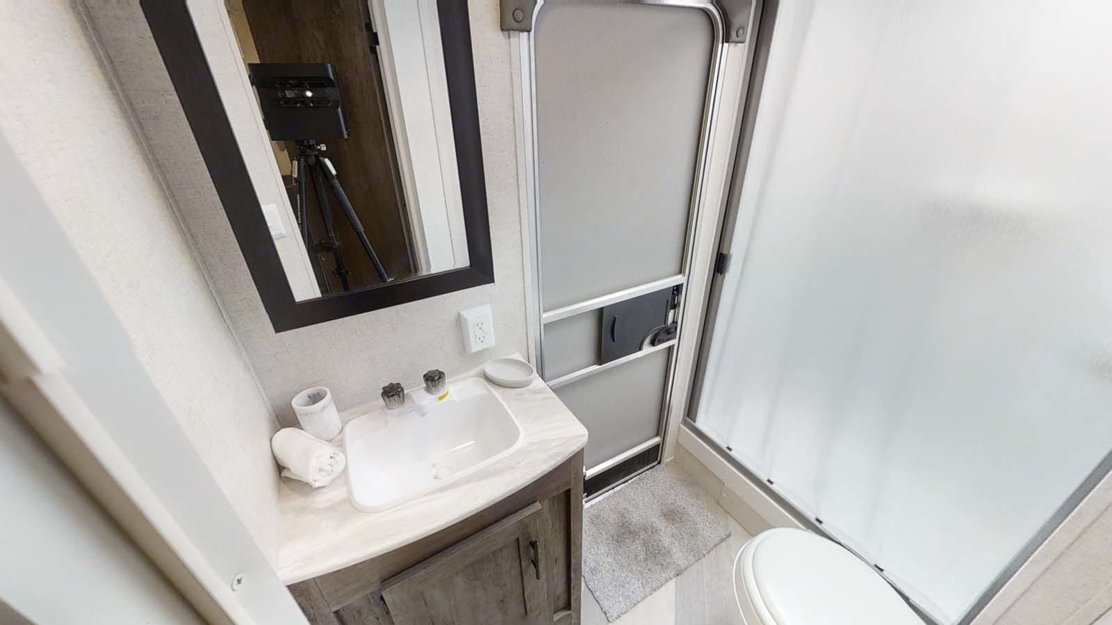 Tub, Shower, toilet, vanity, and separate door to keep wet, muddy feet coming in one entrance!. Forest River Salem Cruise Lite 2020