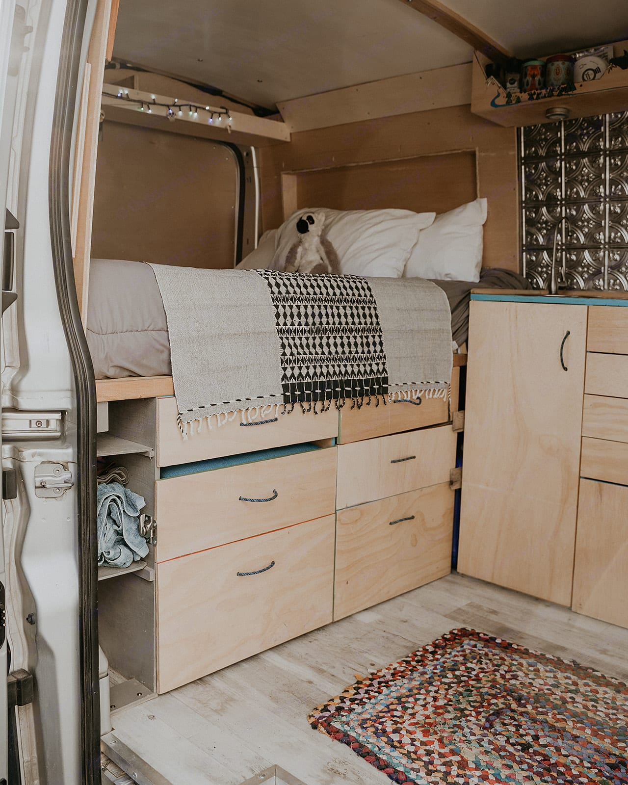 Cozy platform bed with ample storage underneath.. Ford Transit 2015