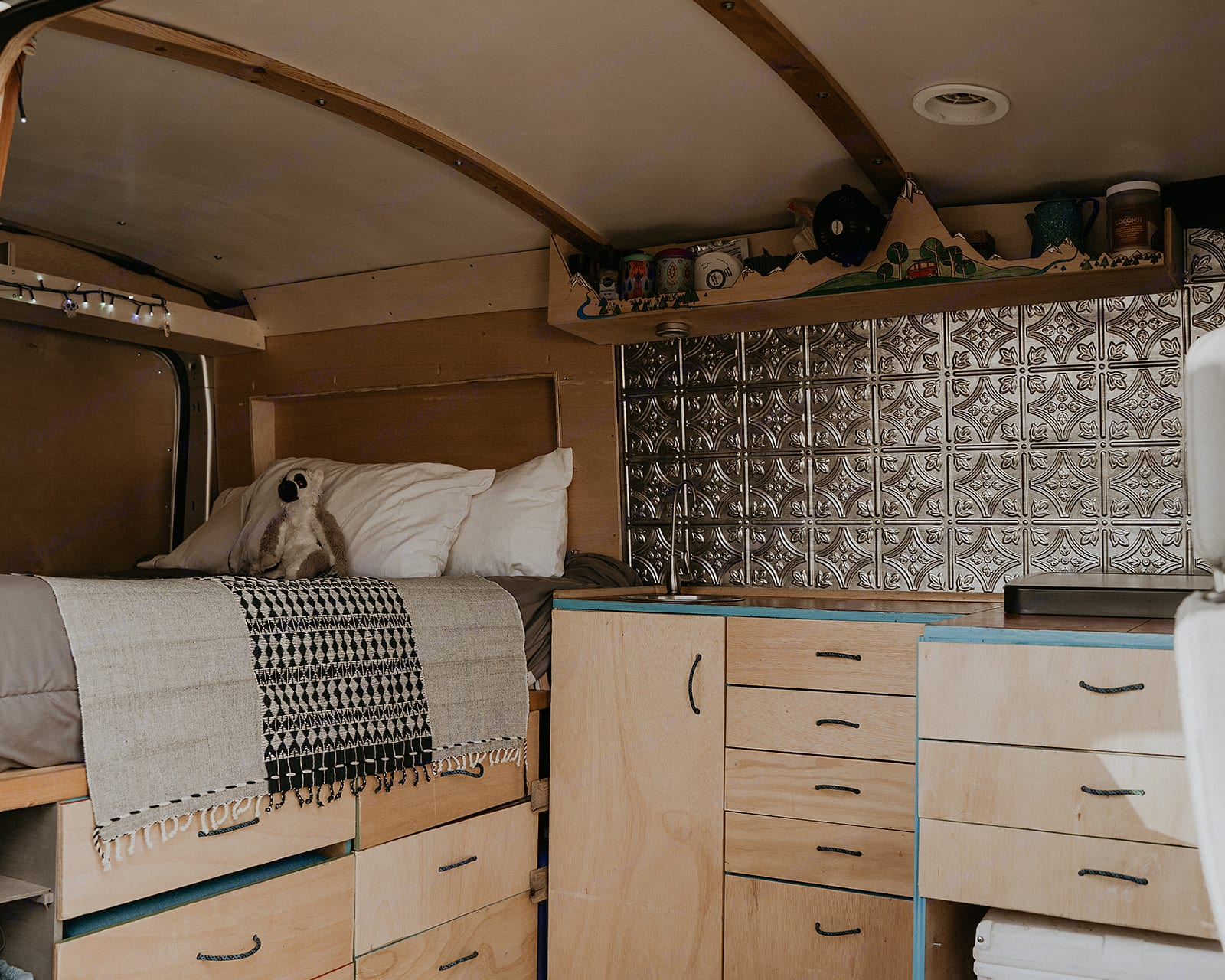 Bohemian touches throughout make for cozy nights.. Ford Transit 2015