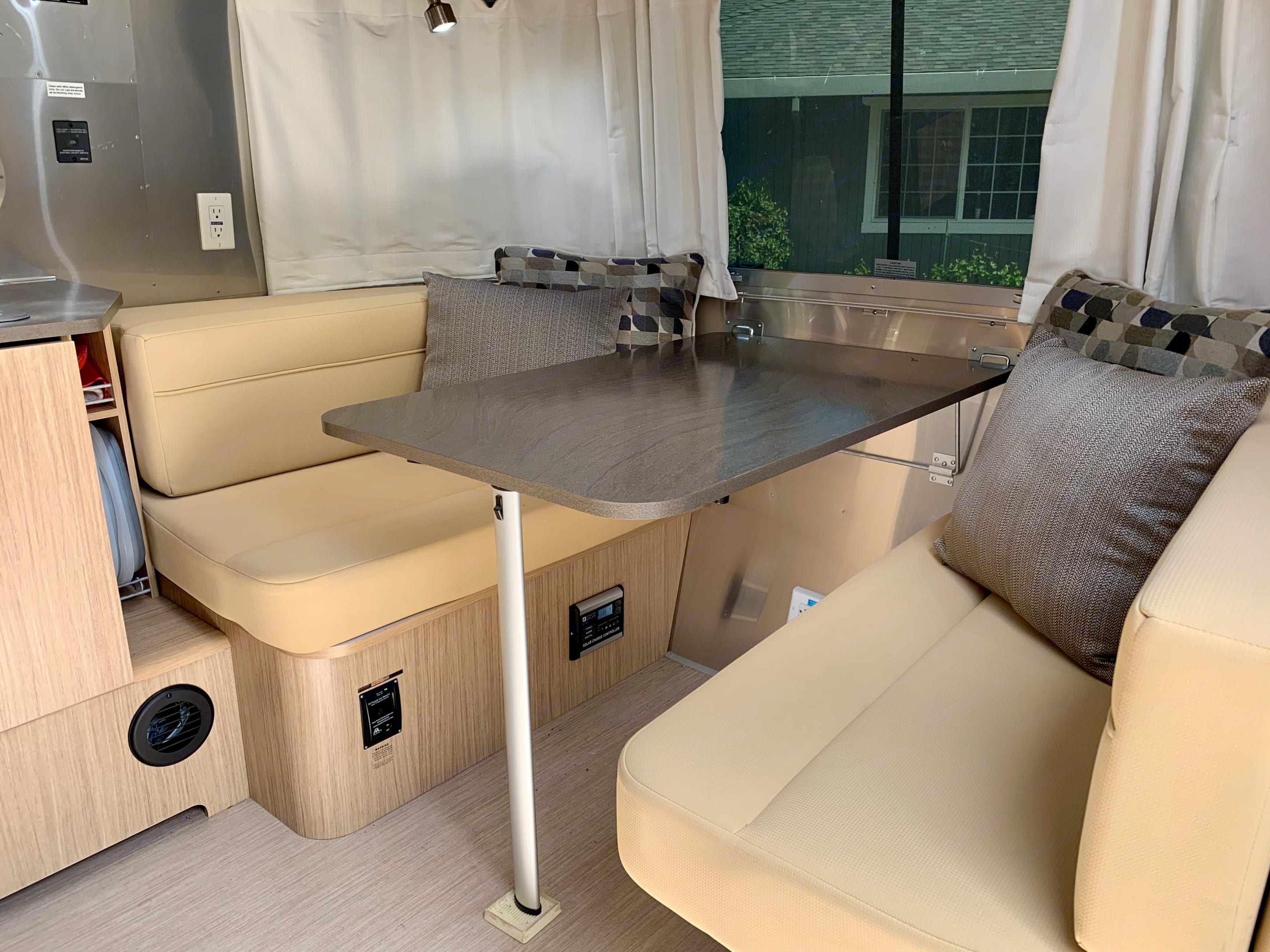"""Dinette dining area with memory foam cushions, collapses to make a dinette bed 40x91"""". Airstream Flying Cloud 2019"""