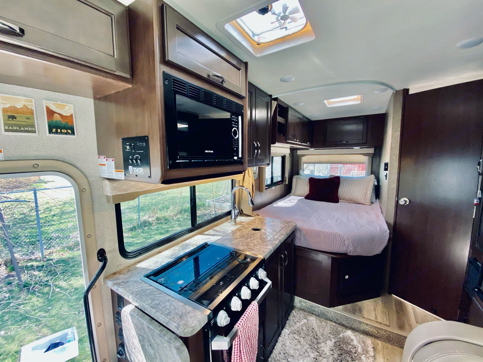 queen bed with curtain. Thor Motor Coach Freedom Elite 2020