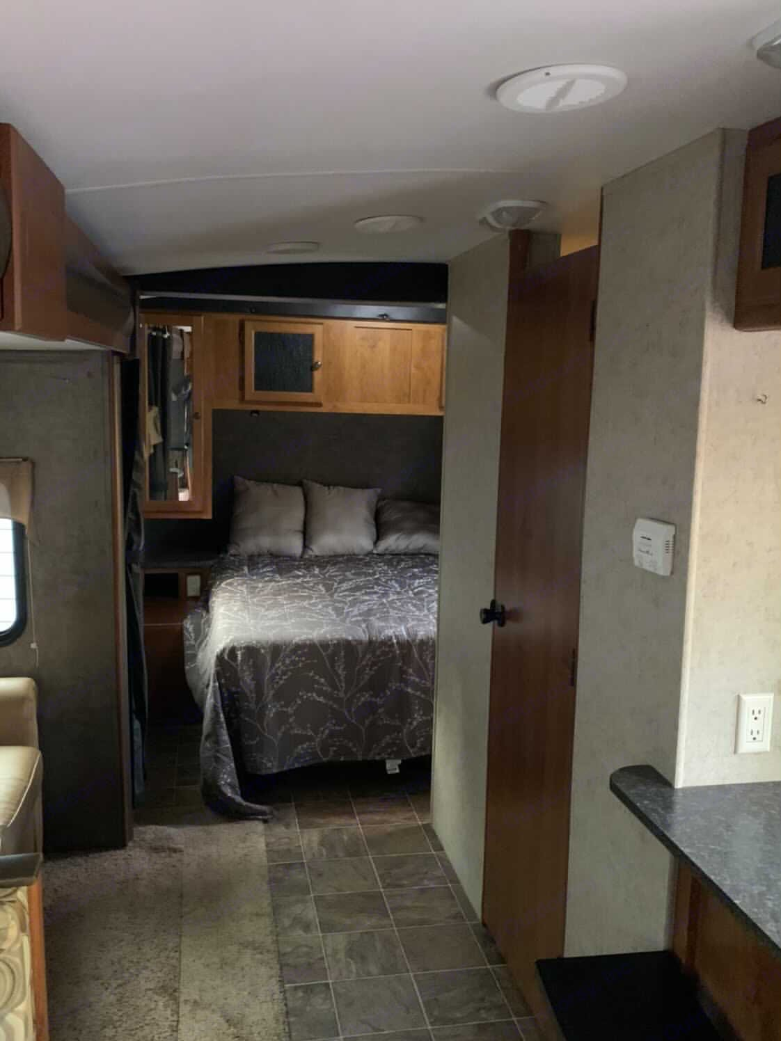 queen size bed with privacy curtain. Heartland Wilderness 2014