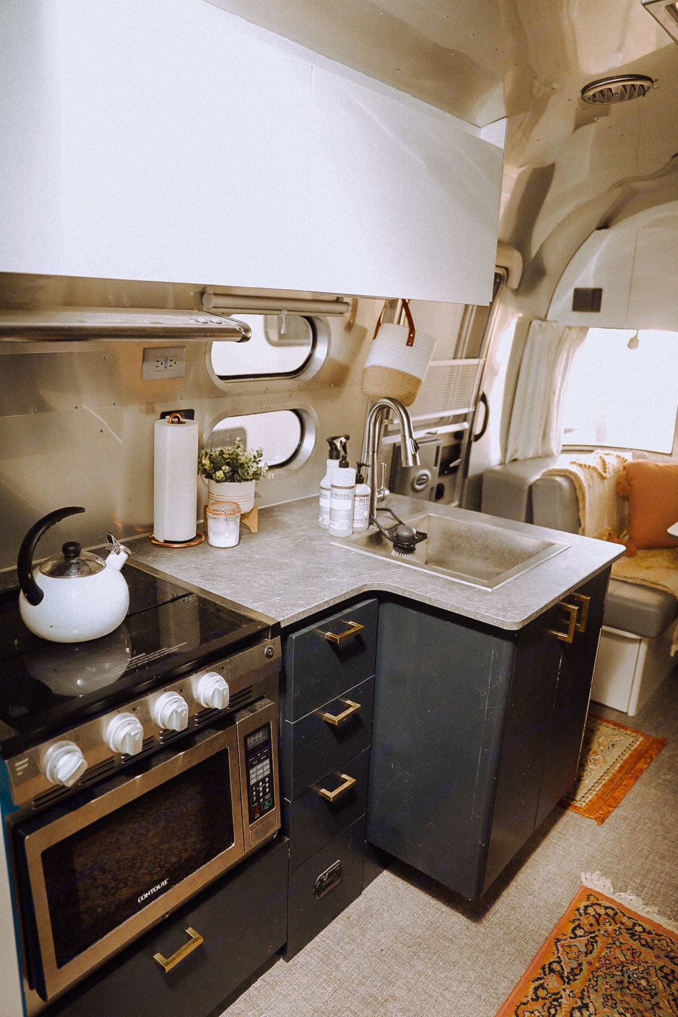 The sink has a cover that turns it into more counter space. . Airstream Flying Cloud 2021