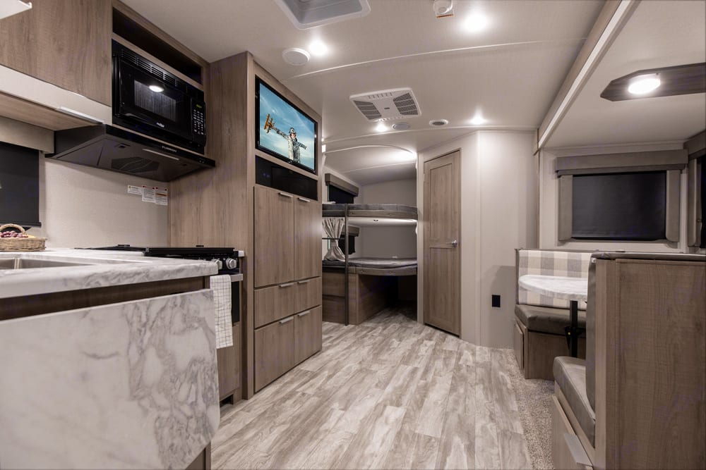 """Looking back from the Master Bedroom. Bright, spacious and a very functional layout. The 81"""" ceiling height makes it feel even bigger!. Grand Design Imagine 2400BH 2022"""