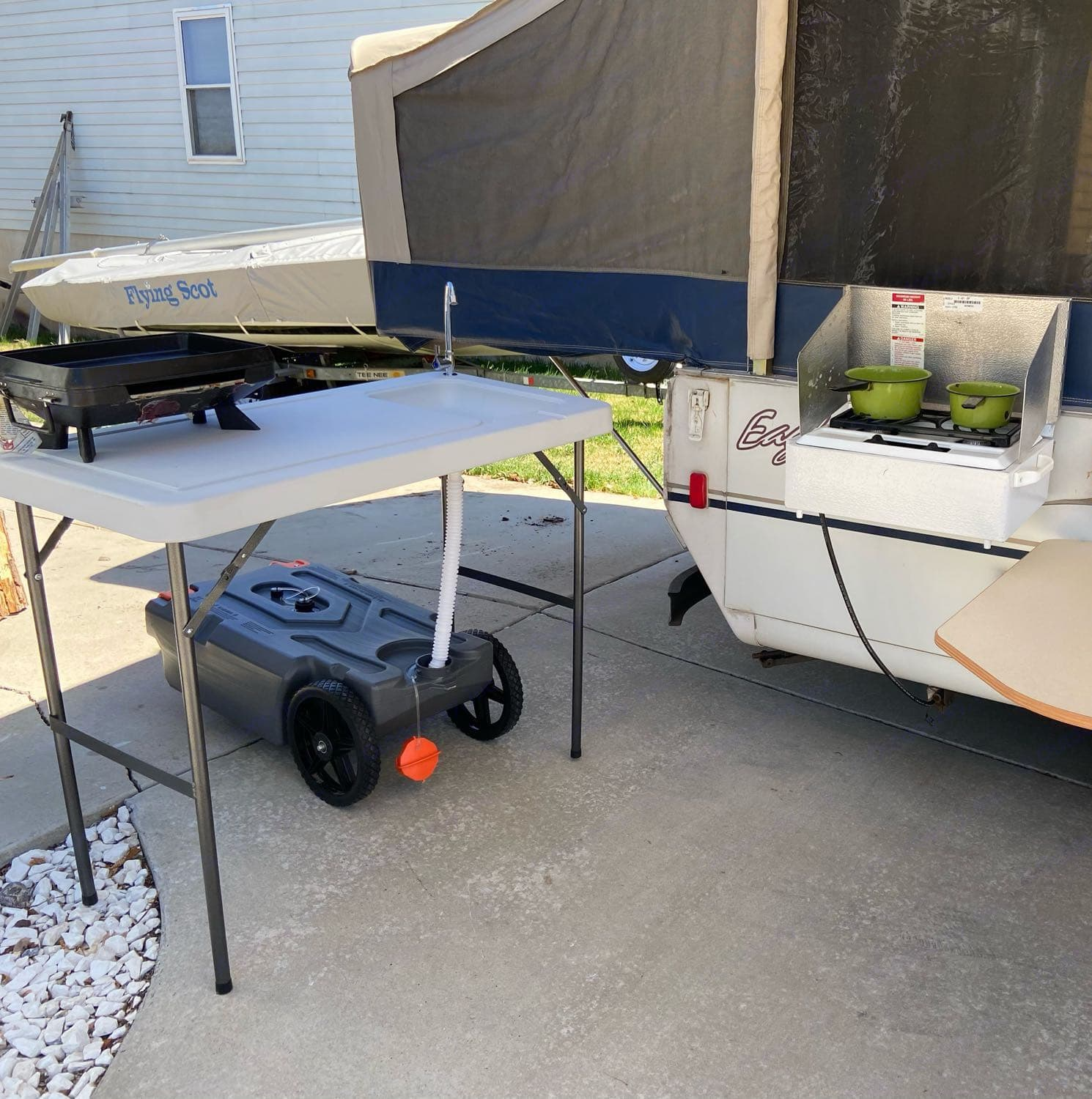 Here you can see the outdoor kitchen setup. With two cooktops and an outdoor sink this rig is ready to go. . Jayco Eagle 2003