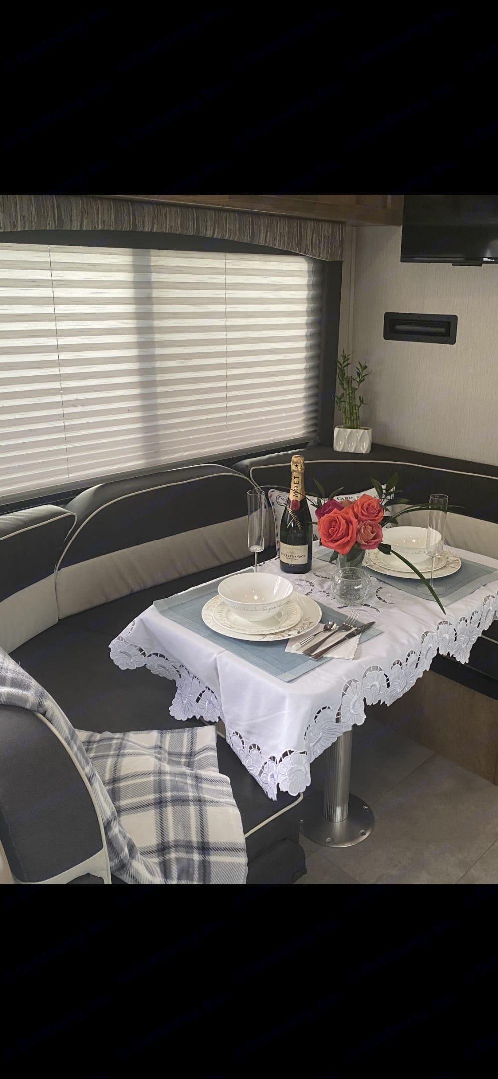 Dining area/bed area. Coachmen Leprechaun 2021