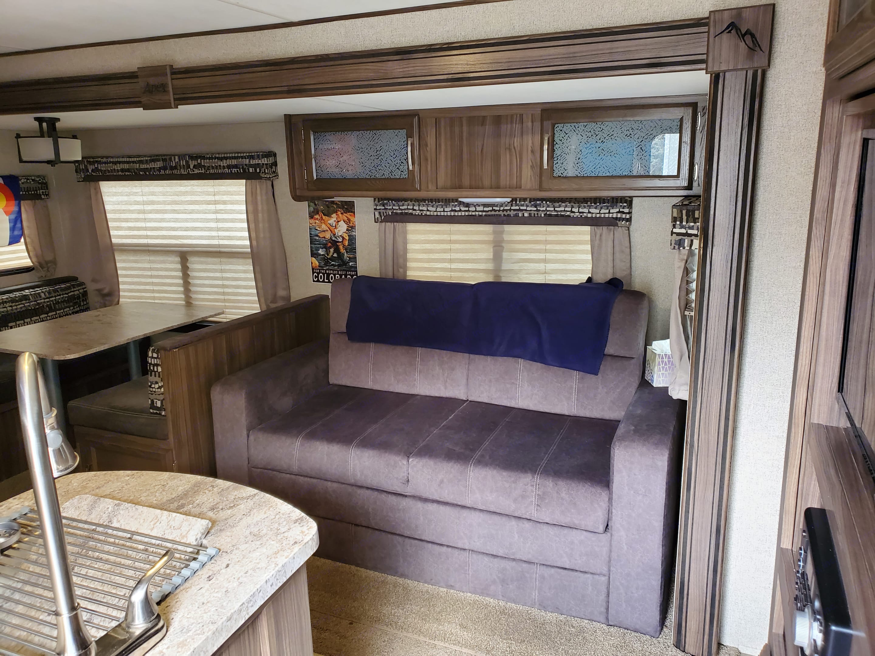 This couch actually folds out to a full queen sized bed with a full set of dishes and games above the couch!. Coachmen Apex 2018