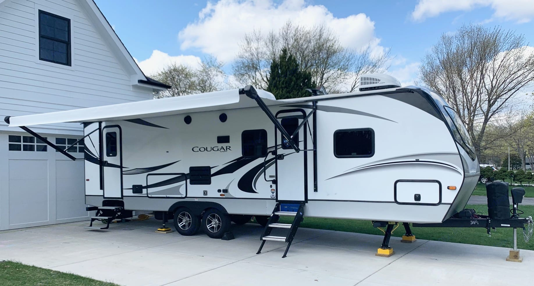Full pass through storage up front.  Two entry doors (main space and bathroom)  Awning and outdoor cook area.. Keystone Cougar 2020