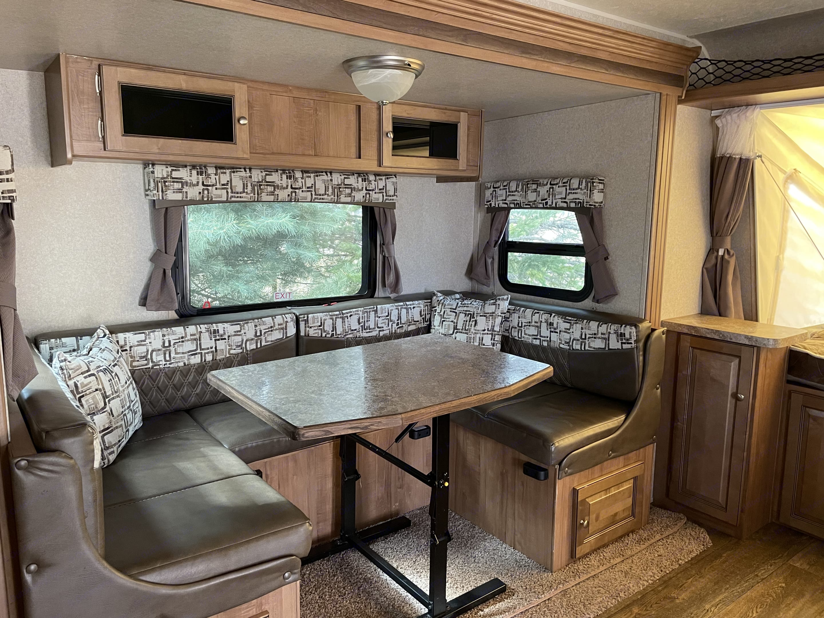 This versatile area is great for dining, playing cards & games, watching TV and converts for a sleeping option. . Forest River Rockwood Roo 2018