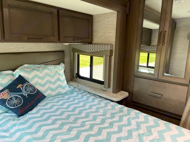 Master queen size bed with walk around room. Thor Motor Coach Freedom Elite 2021