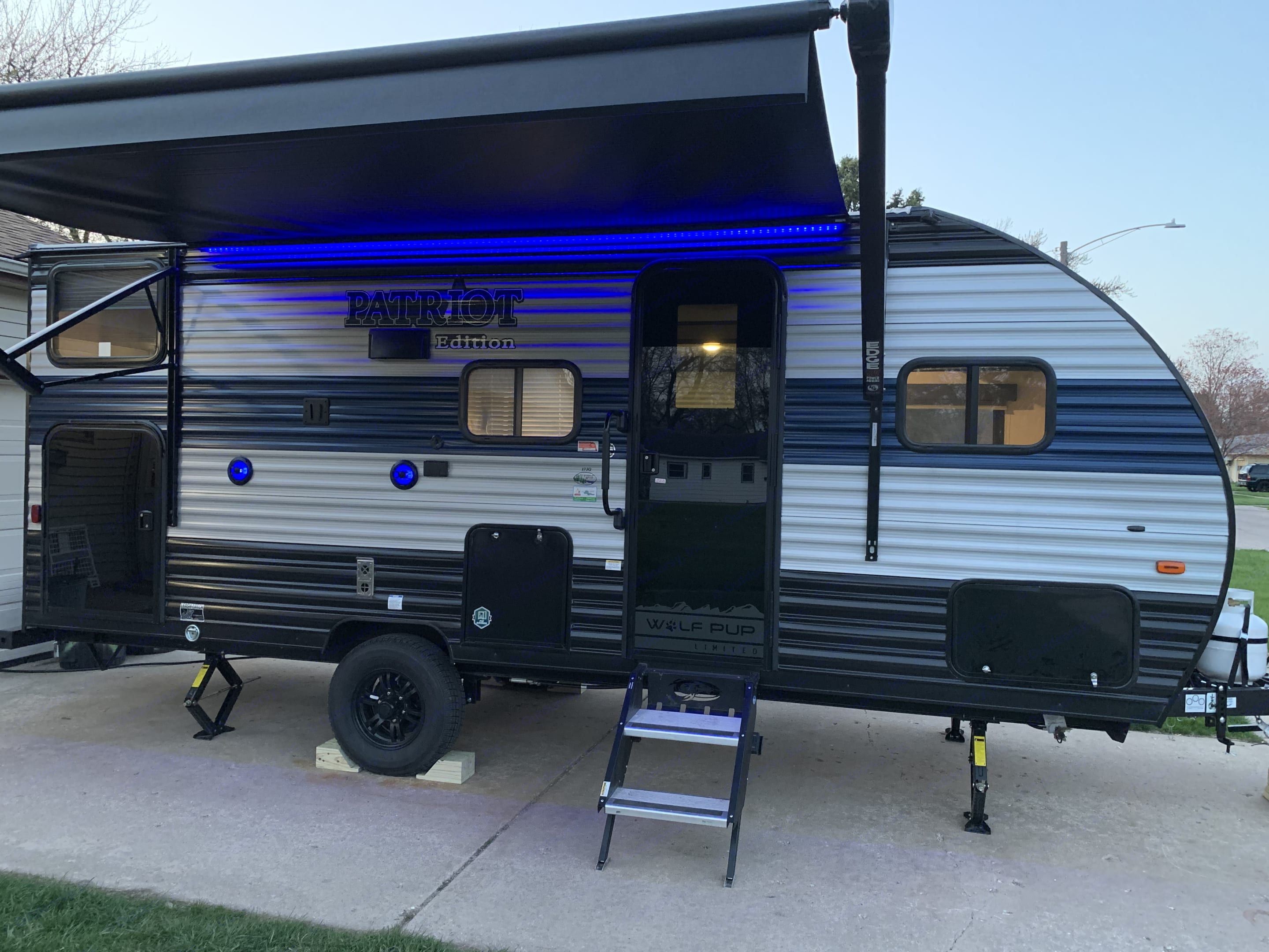 Nice big awning that is controlled from a smart phone or from inside the camper.  Lights under the awning are great after the sun goes down.  . Forest River Cherokee Wolf Pup 2021