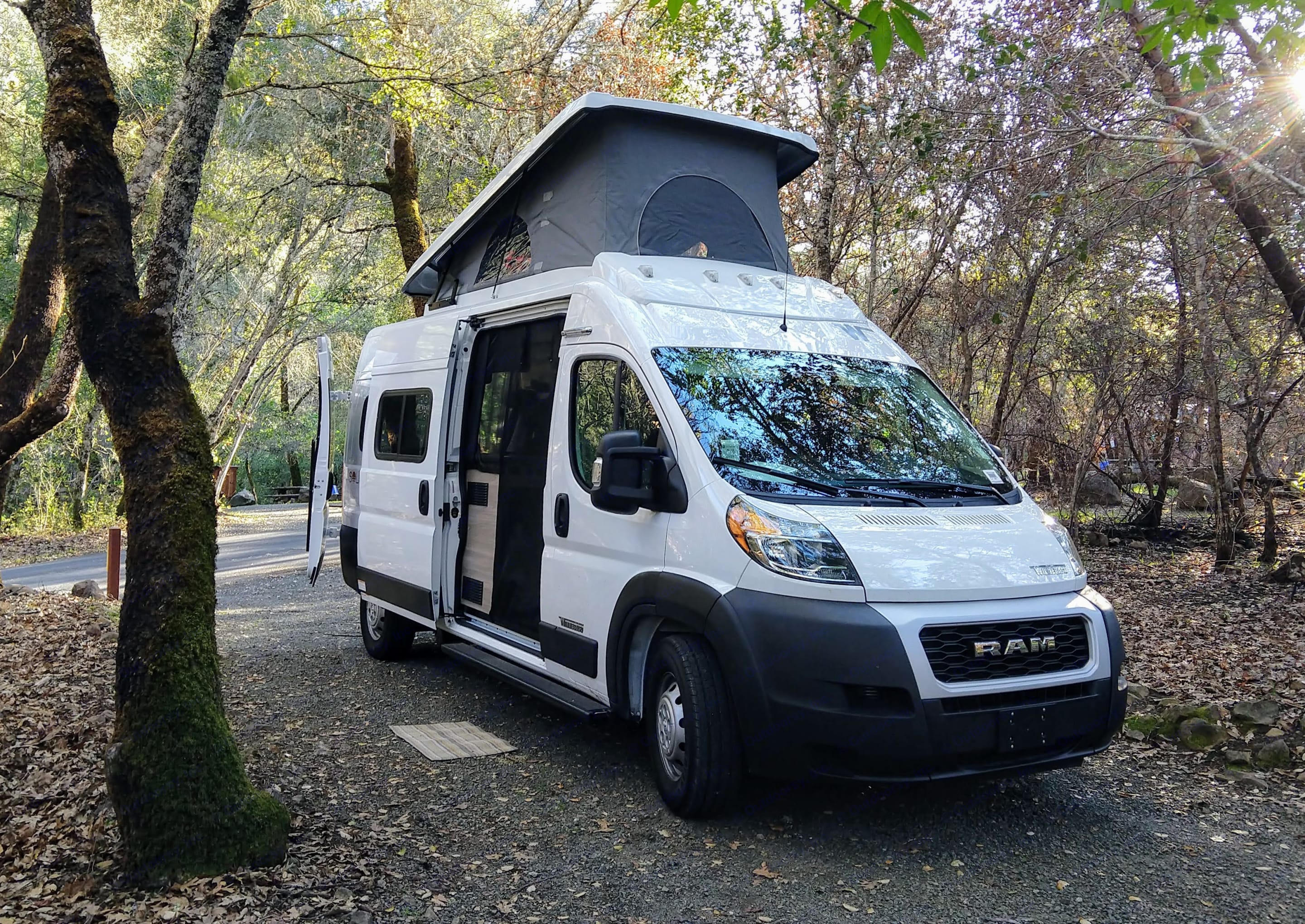 The pop top is one of the Solis' best features - with a comfy full-size bed and three windows, it's like sleeping in a tree house!. Winnebago Other 2021