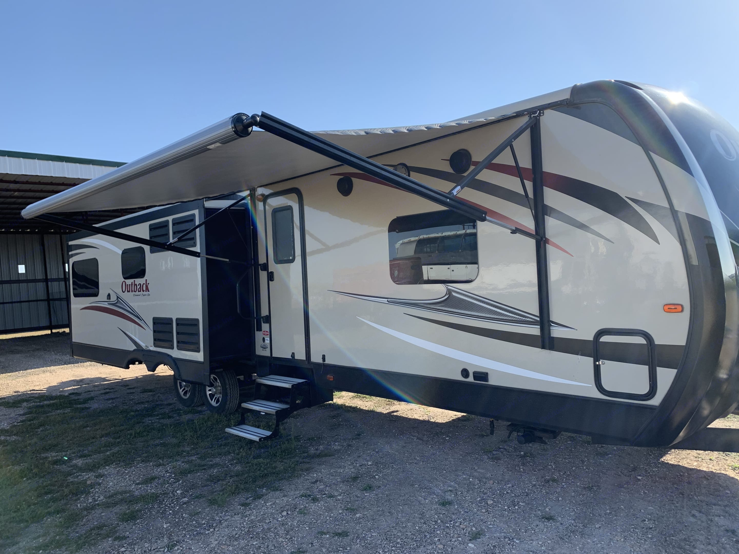 Huge outdoor awning for relaxing outside!. Keystone Outback 2017