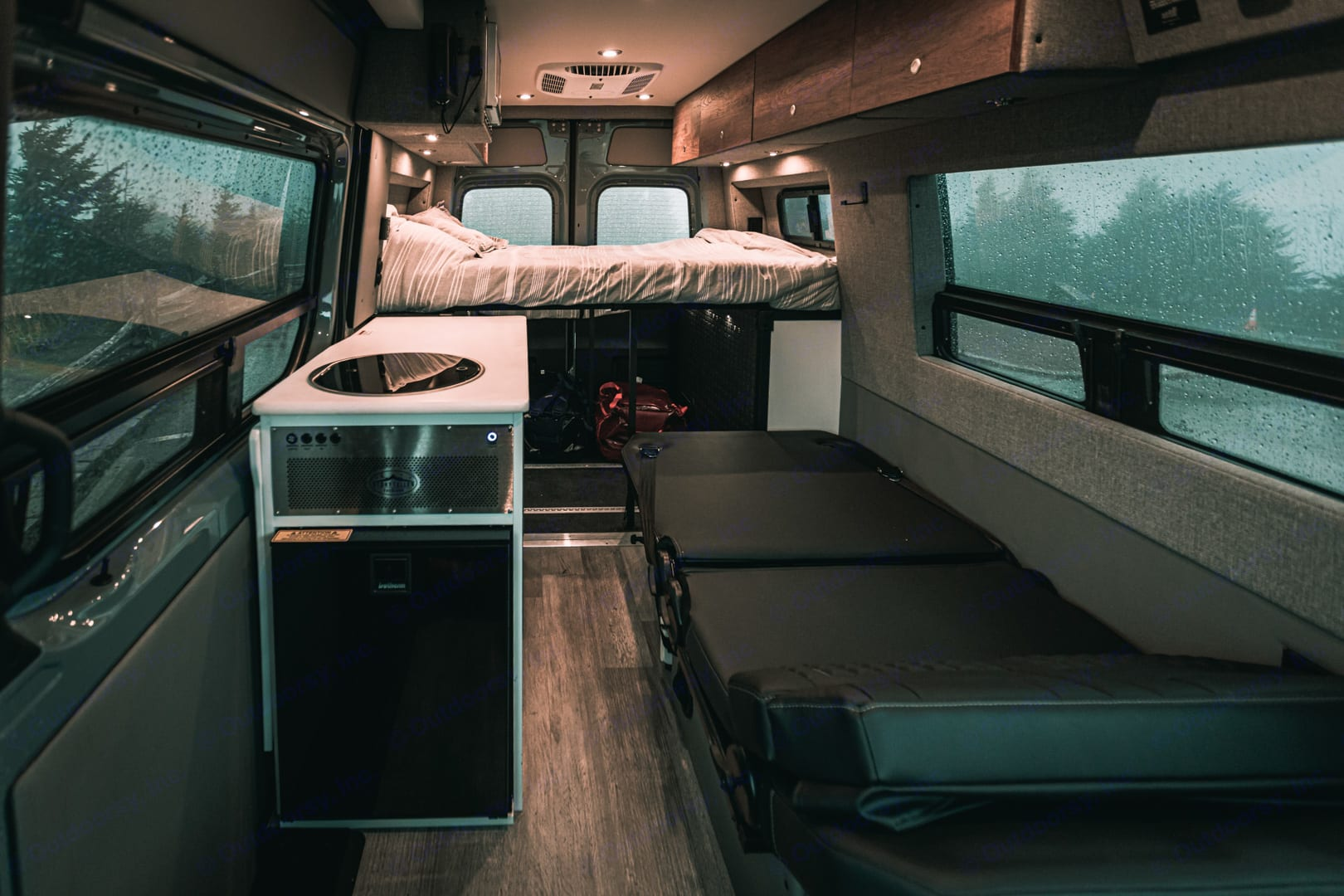 The back bench seat folds down into a bed.. Mercedes-Benz Storyteller Overland Stealth MODE 4x4 2021