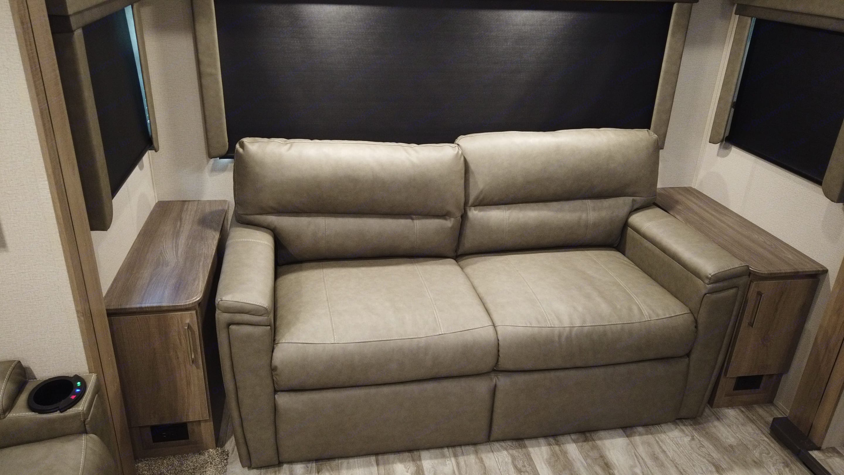 This loveseat pulls out into a full-size bed.. Grand Design Imagine 2021