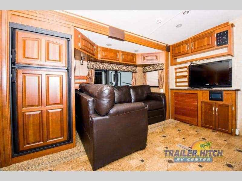 Comfy L shaped couch with pull out bed, sleeps 1 adult or 2 small children.. Winnebago One 2014
