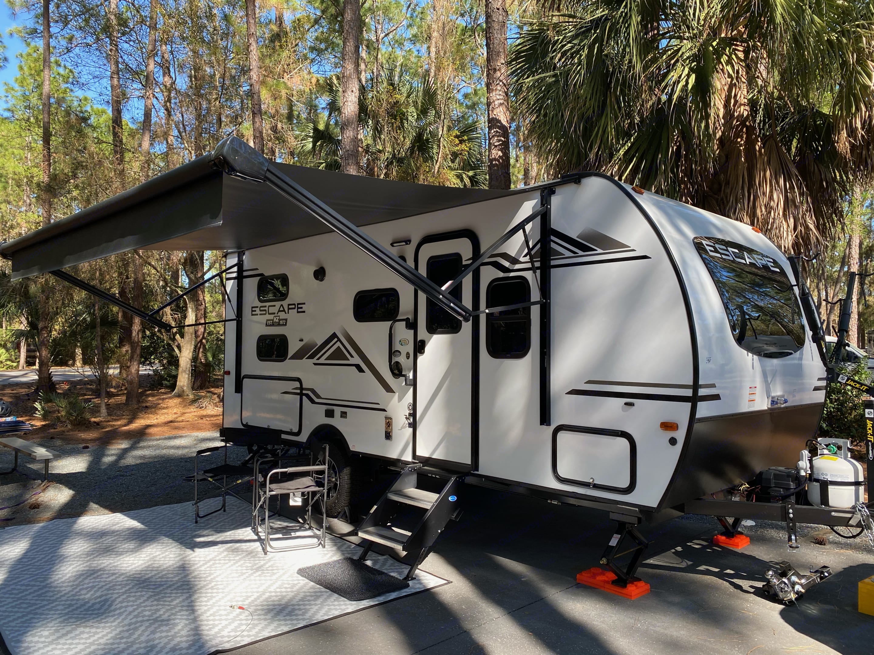 Our trailer has a great outdoor setup.  An extra long awning, outdoor speakers, and lights.. K-Z Manufacturing Escape 2021