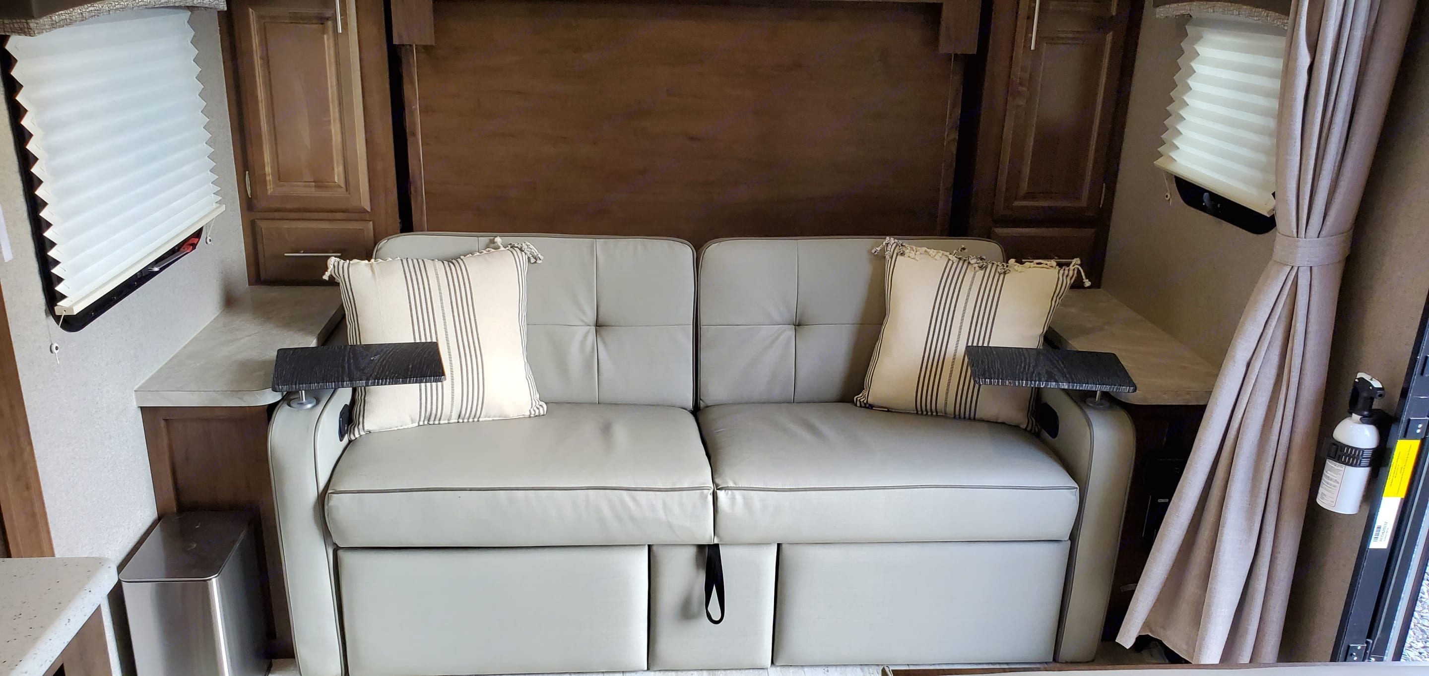 Sofa by day lays flat at night so  queen murphy bed can be folded down.  Very comfy.. Forest River Mini-Lite 2019