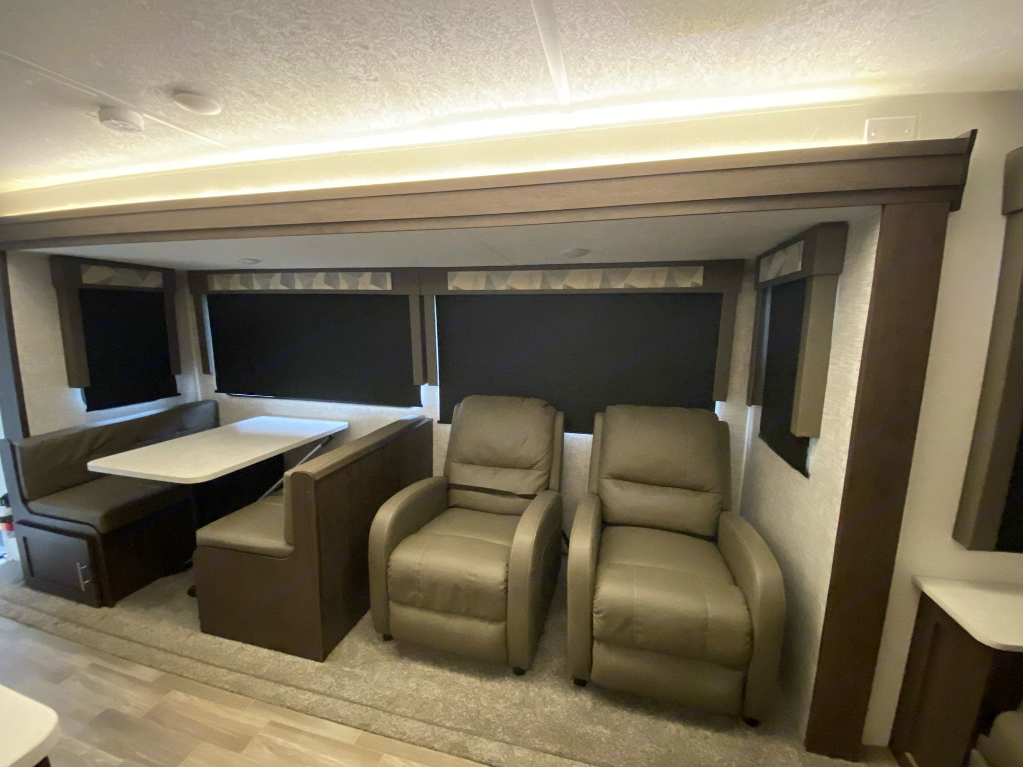 Double Recliners and Table converts to bed. Forest River Salem 2020