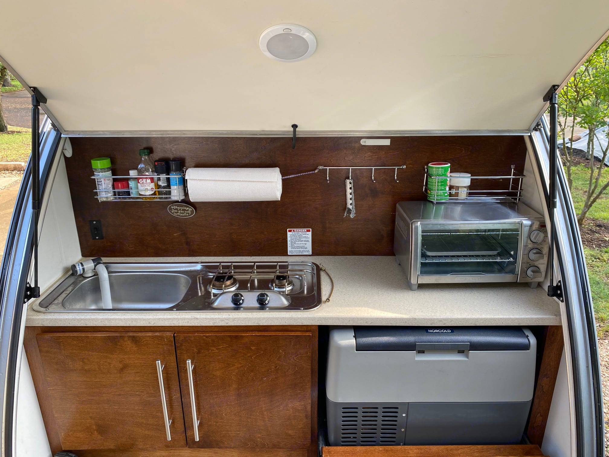 Sink with 5 gal water tank, 2 burner propane stove top, toaster oven or microwave, Mini fridge. Little Guy T@G 2015