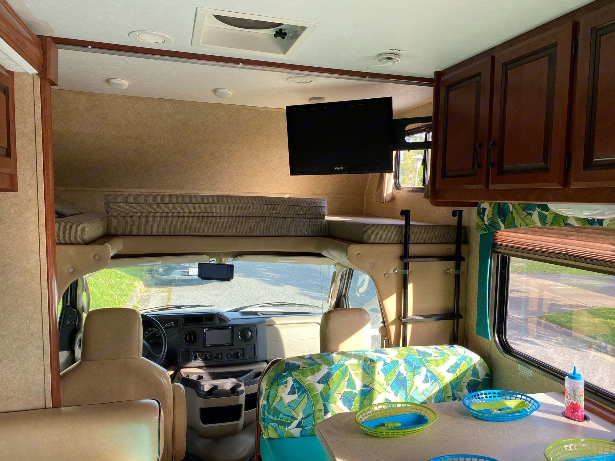 2 adults can sleep comfortably here. Front half folds up during driving for added head space. Television arm swings in our out for viewing ease.. Forest River Sunseeker 2013