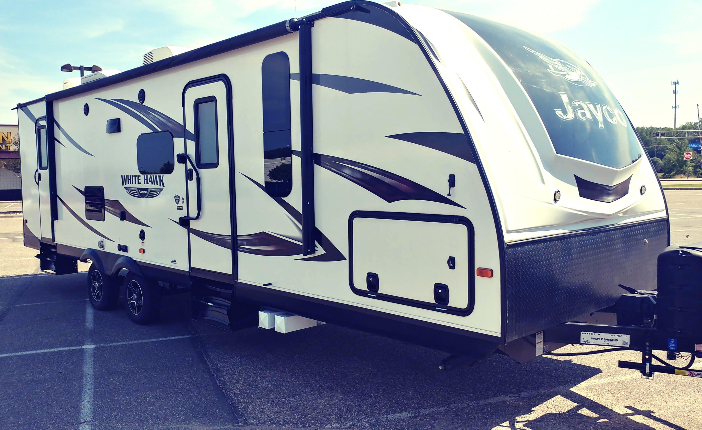 Camper has wind break for easy of towing.. Jayco White Hawk 2016