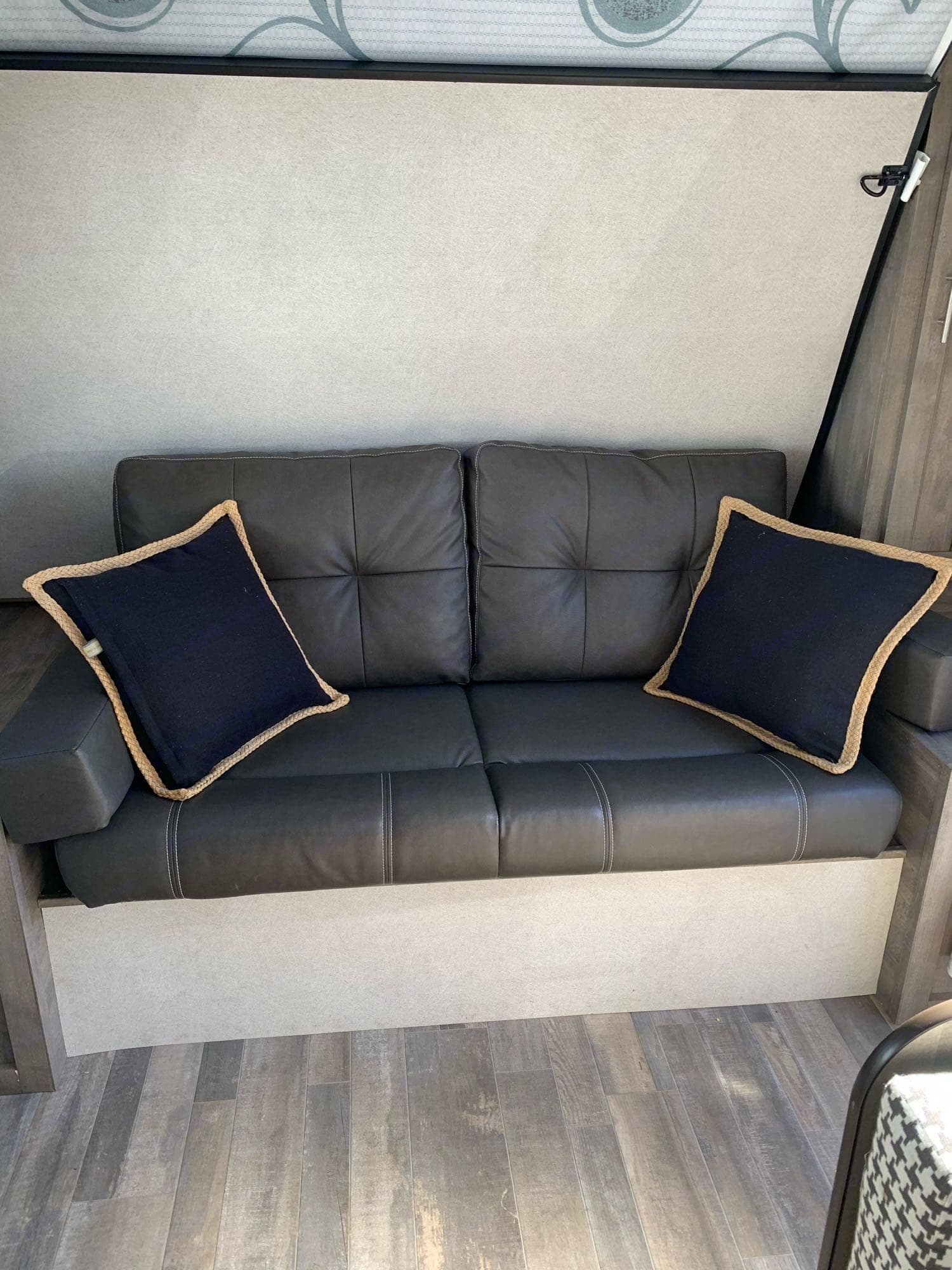 Couch with Murphy bed. Forest River Vibe 2020