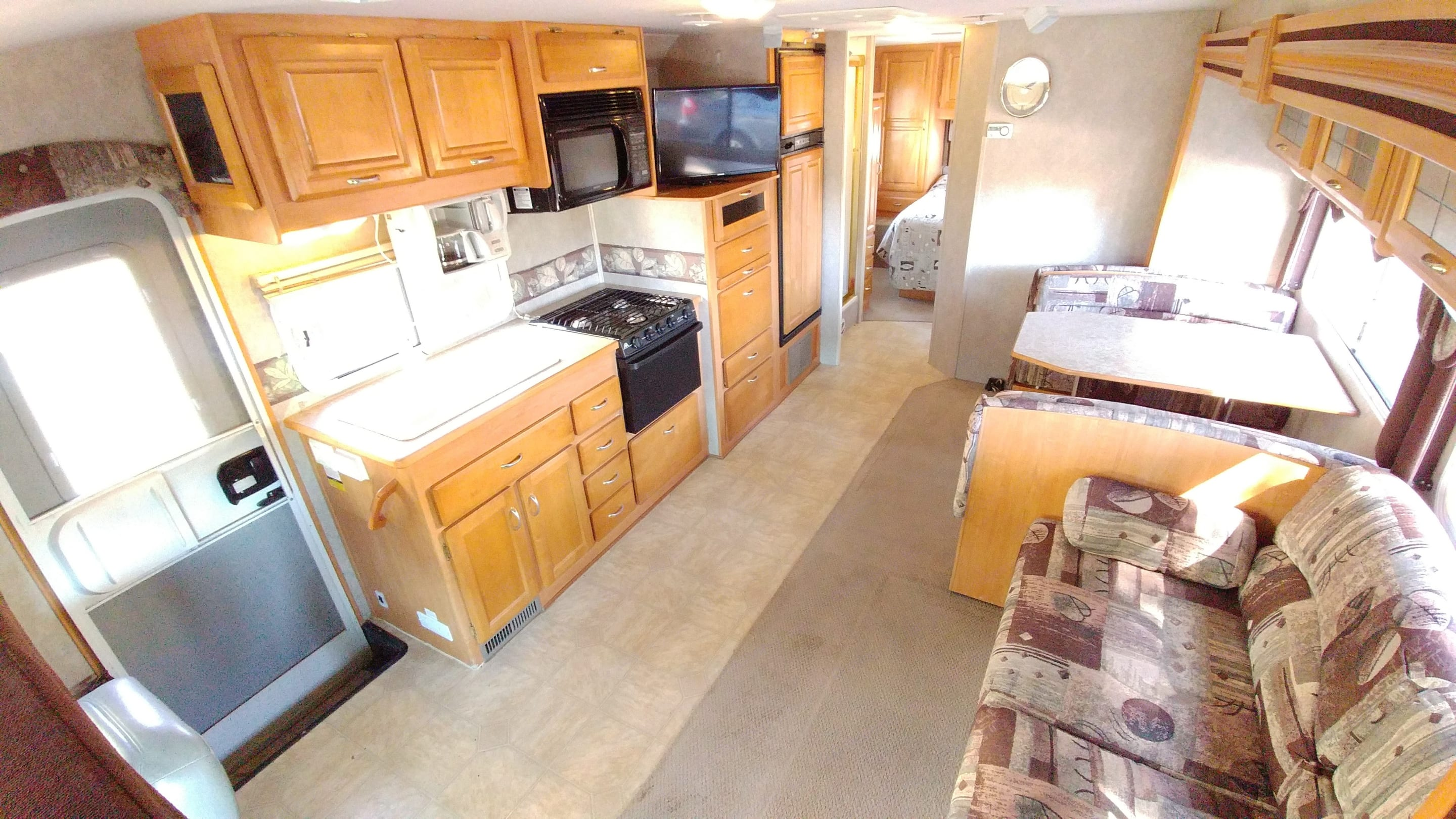 Here's the spacious living area, kitchen, dining table and couch. . Jayco Greyhawk 2005