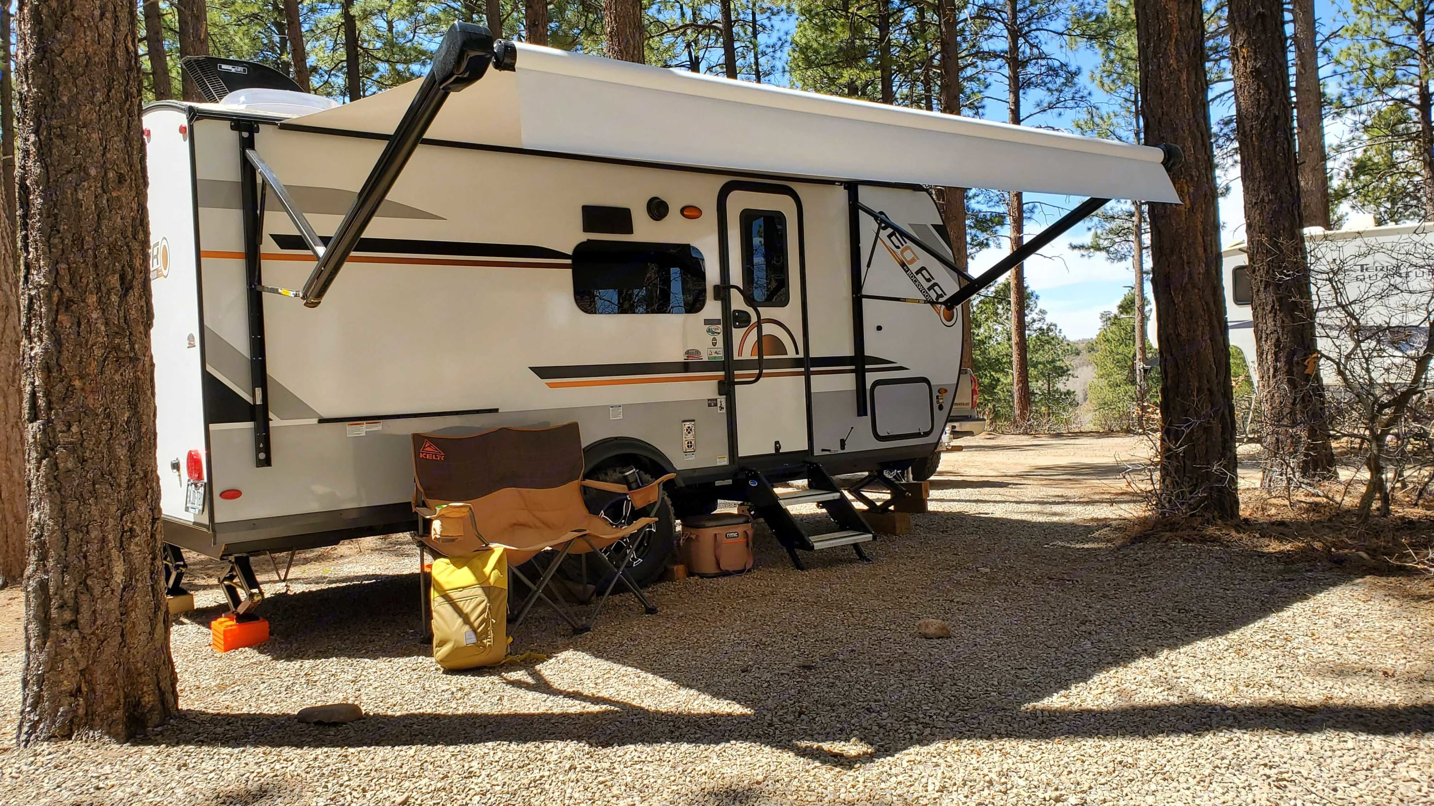 Electric awning makes deployment a snap!  Adjust angles for increased shade. Push the button to stow away (don't leave awning open unattended).. Forest River Rockwood Geo Pro 2021