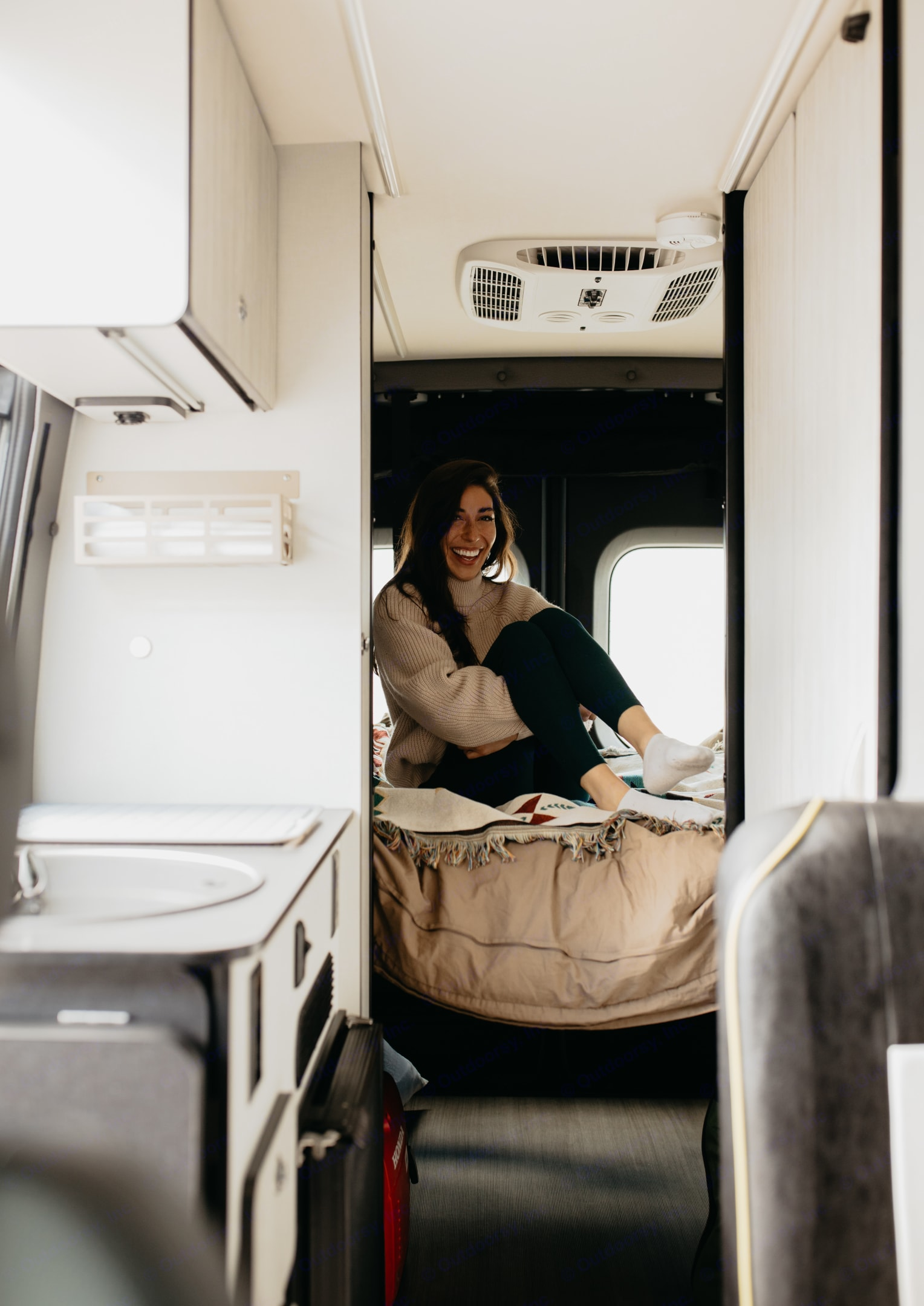 The platform bed adjusts in height to make room for larger items like bikes.. Winnebago Revel 2020