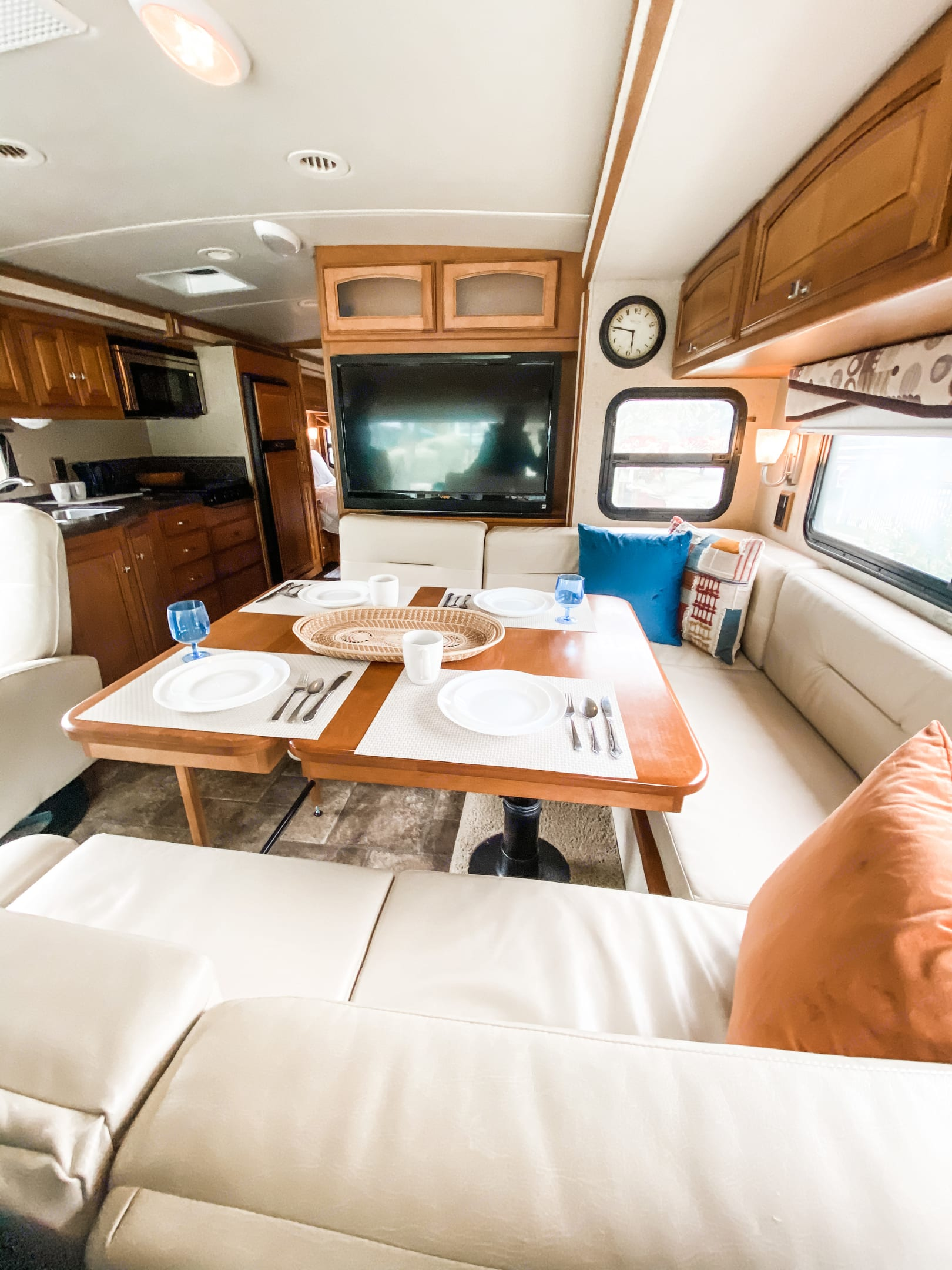 The dining table extension provides ample space for family dining or a large workspace for remote work. The leather benches are very comfortable. . Winnebago Sightseer 2013