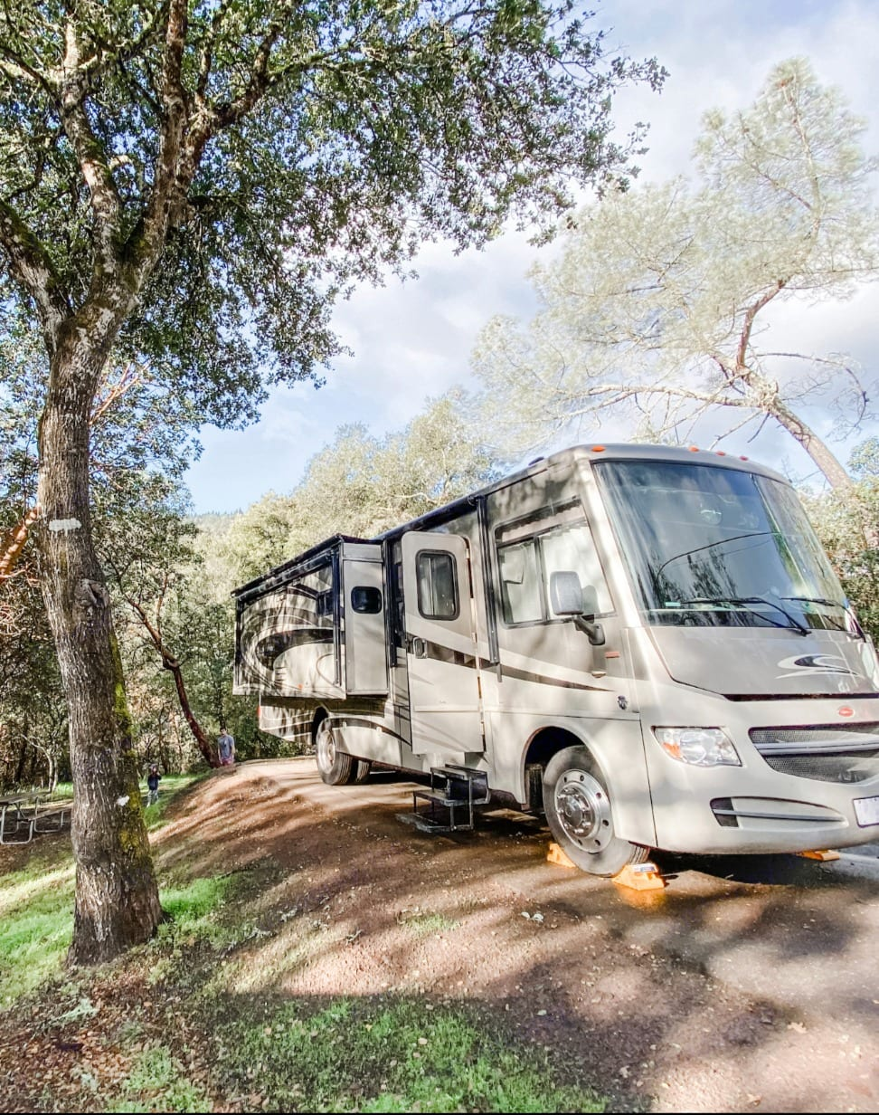 Parked by the Russian River in the shade. . Winnebago Sightseer 2013
