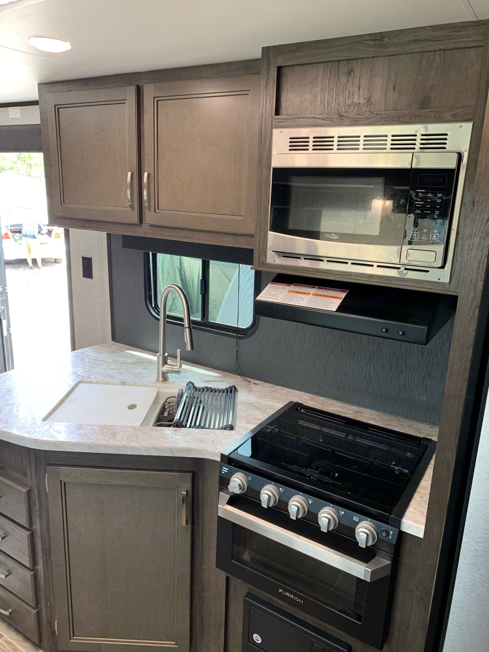 Clean and modern kitchen with nice appliances!. Jayco Jay Feather 2020