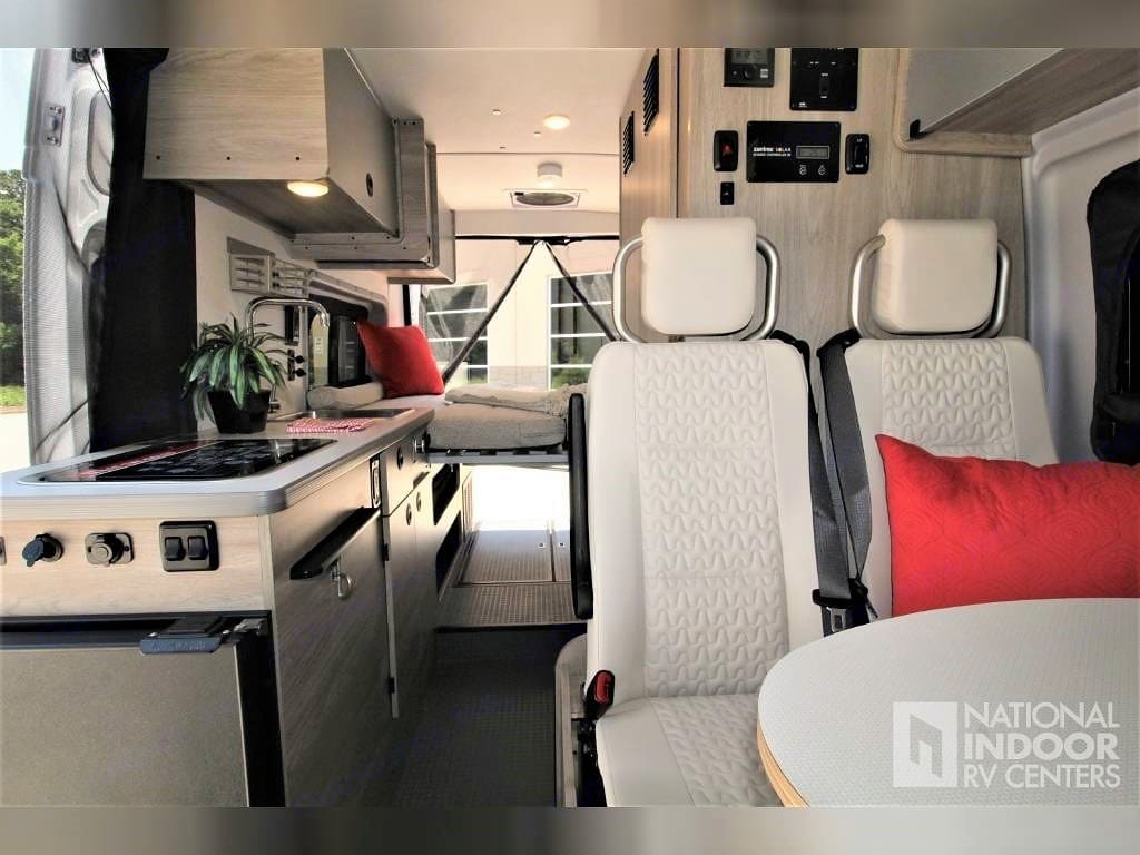 Dinette featuring automotive-grade seating with 3-point seatbelts for more secure travel. Winnebago Solis 59PX 2022