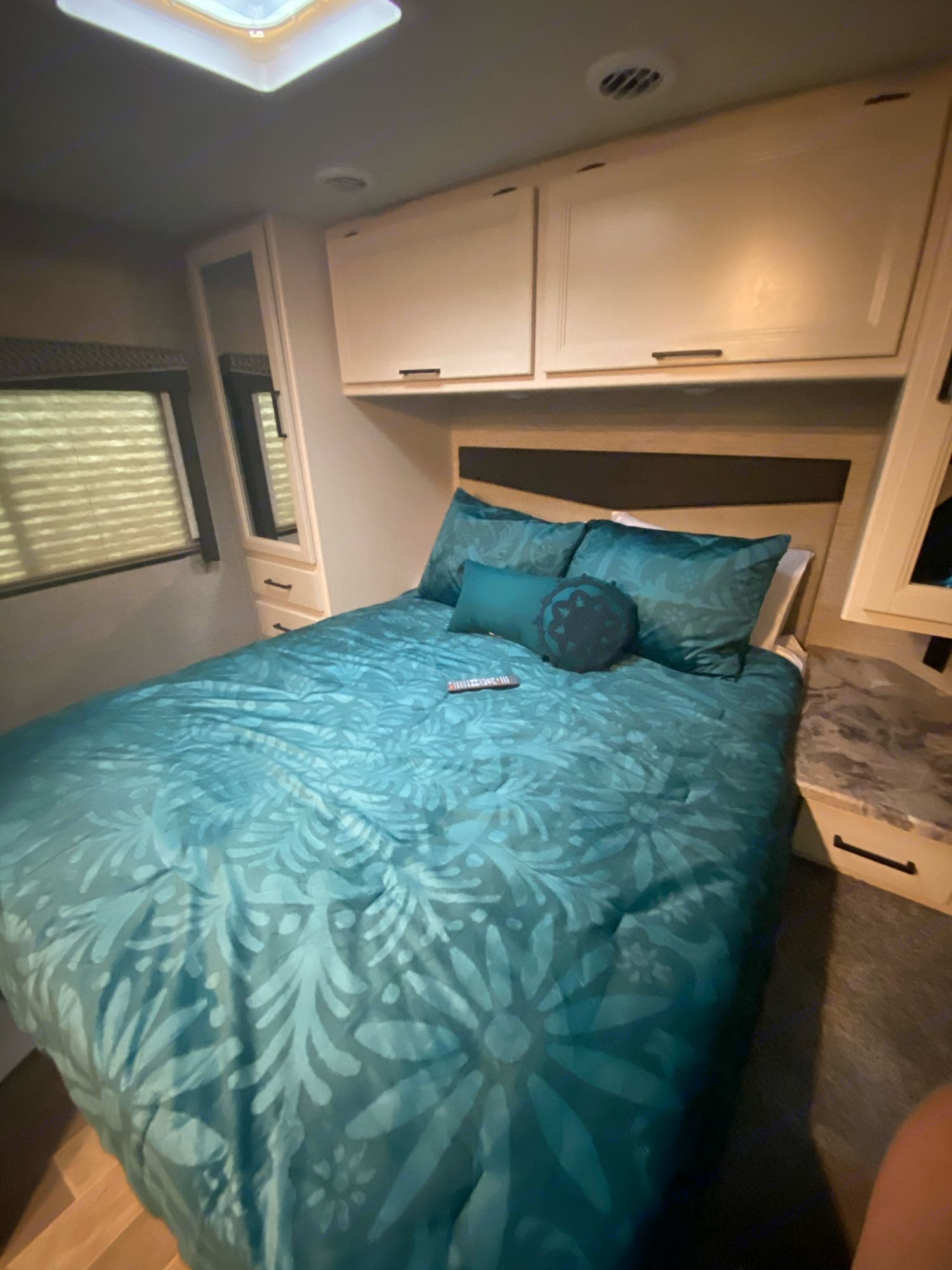 Catch some zzzs in a queen bed topped with a 4 inch memory foam topper - it will be the best sleep you have camping!. Thor Motor Coach Chateau 2021