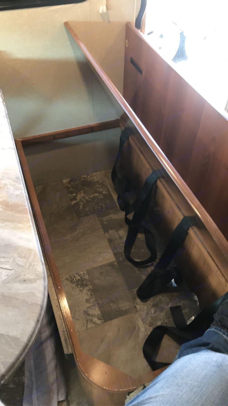 Storage under dinette bench. Coachmen Leprechaun 2019