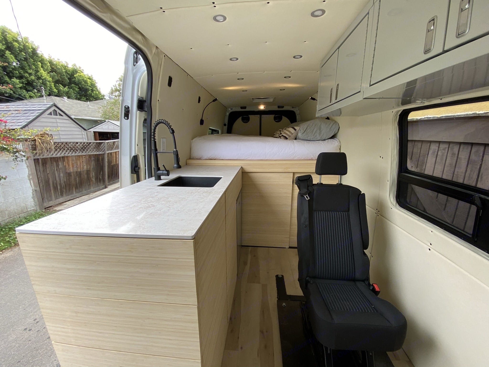 Gorgeous hardwood quiet closing cabinets, hardwood floors, 2 burner induction stove & farm sink. Mercedes-Benz 4x4 Sprinter mwb 2019