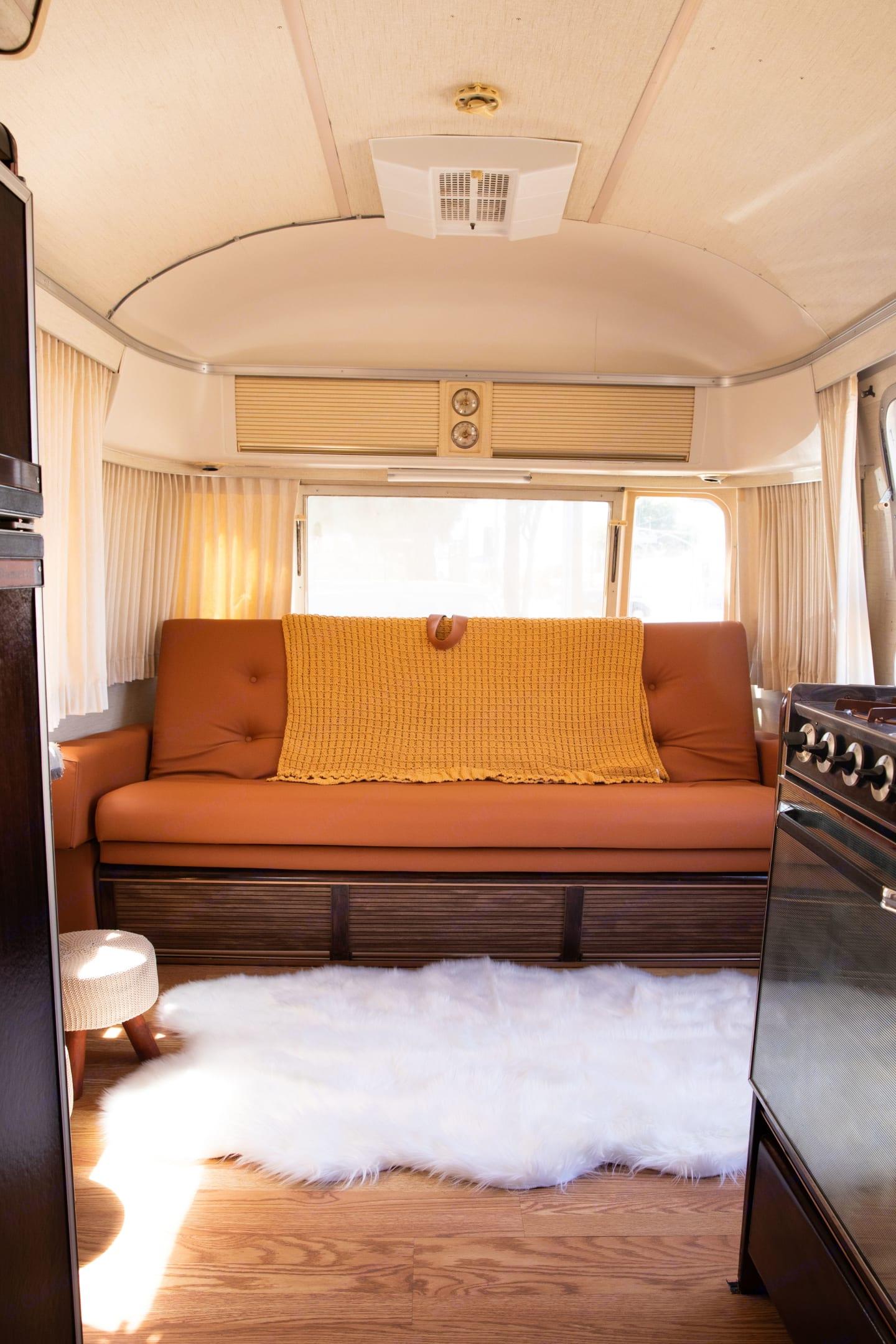 Amazing looking sofa bed.. Airstream International 1976