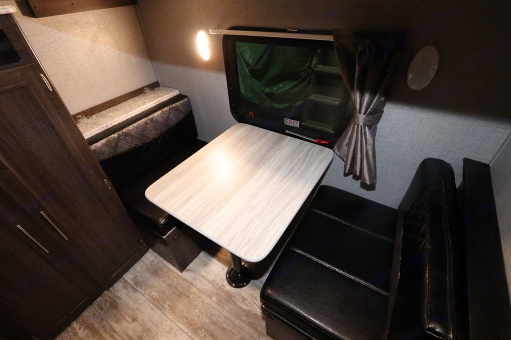 This is a dining set under the third bunk, can be turned into a bed to make a fourth bunk.. Crossroads Zinger 2019
