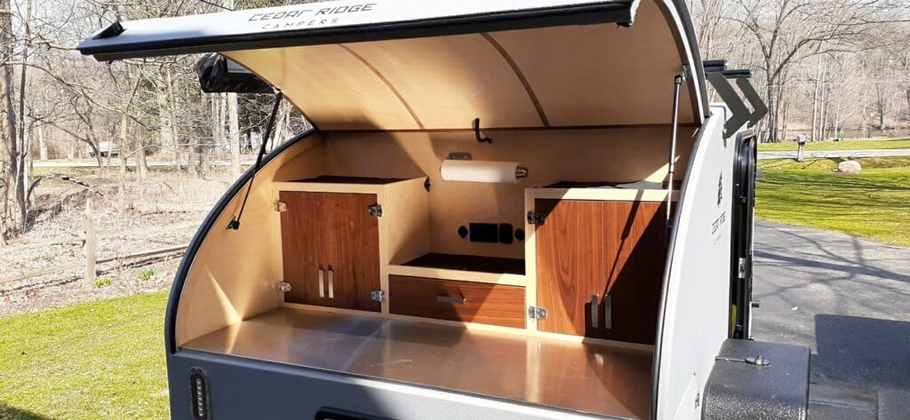 Open up the back to find ample storage for all your food, power, and a stainless steel prep area. . Other Other 2021