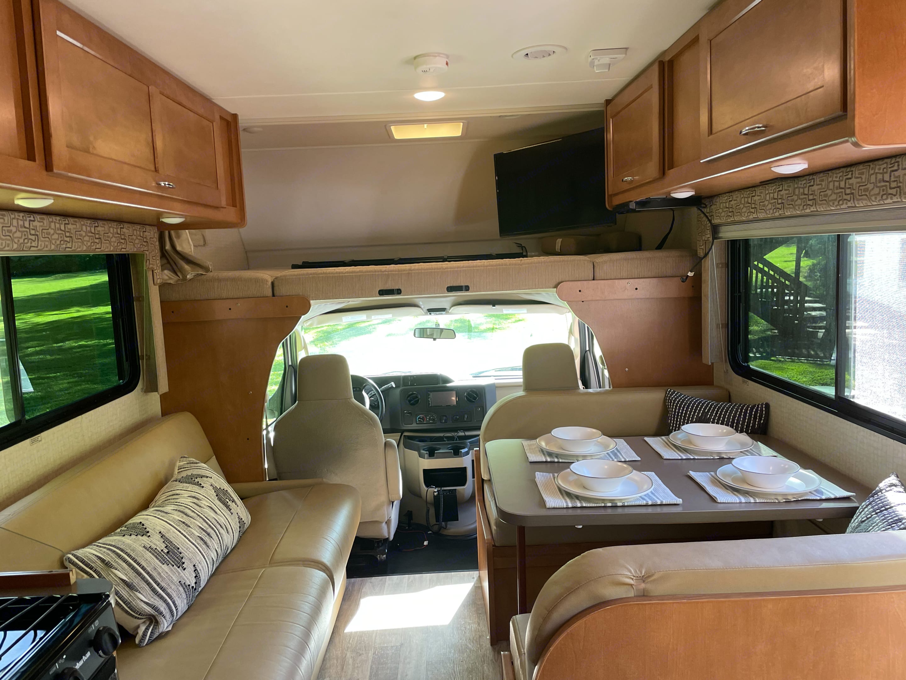Spacious interior. Easily seats 9 people in the front coach and cab. . Winnebago 25B 2018