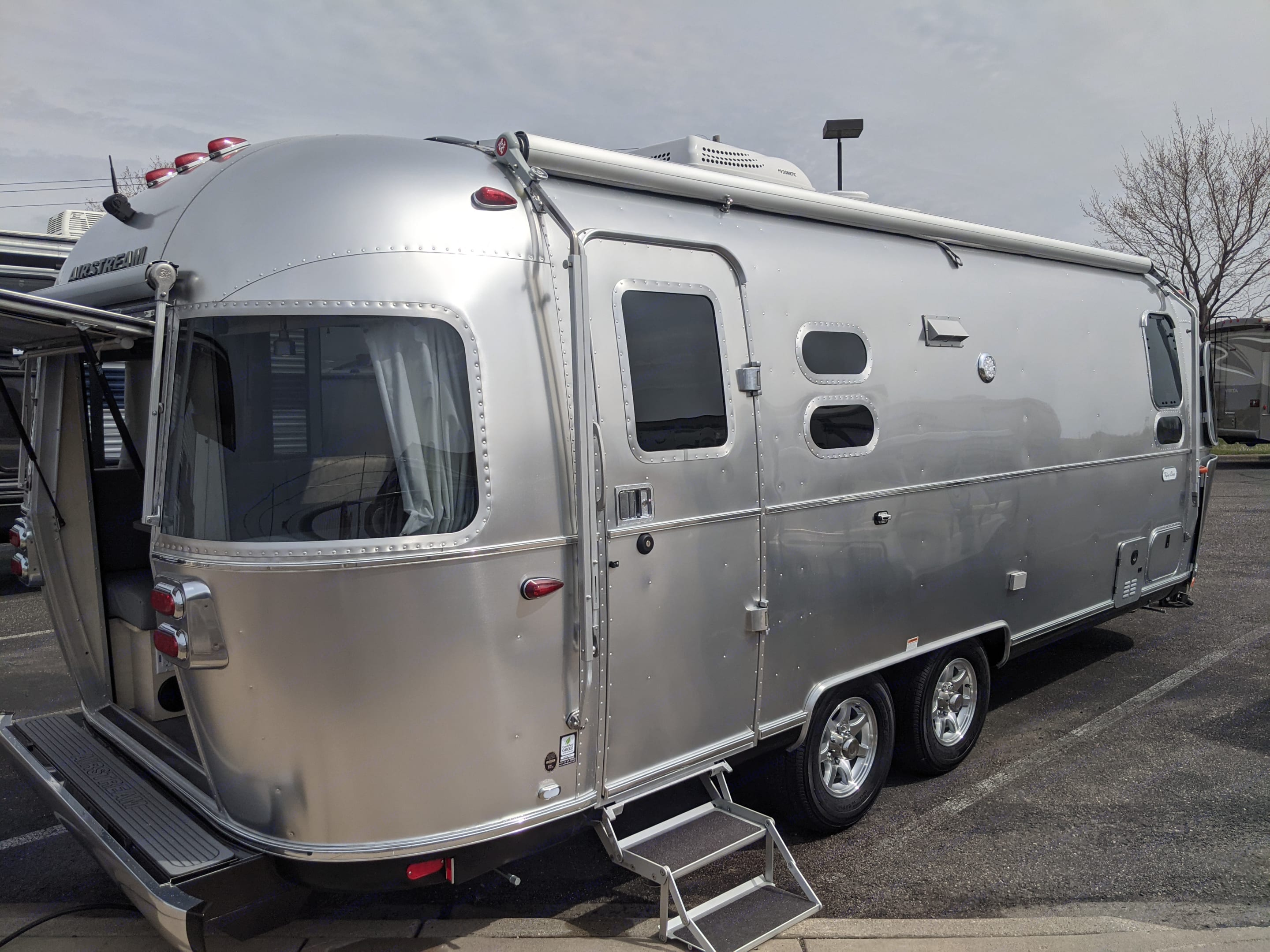 Here she is the day we picked her up from the dealership. Isn't she pretty?. Airstream Flying Cloud 2021
