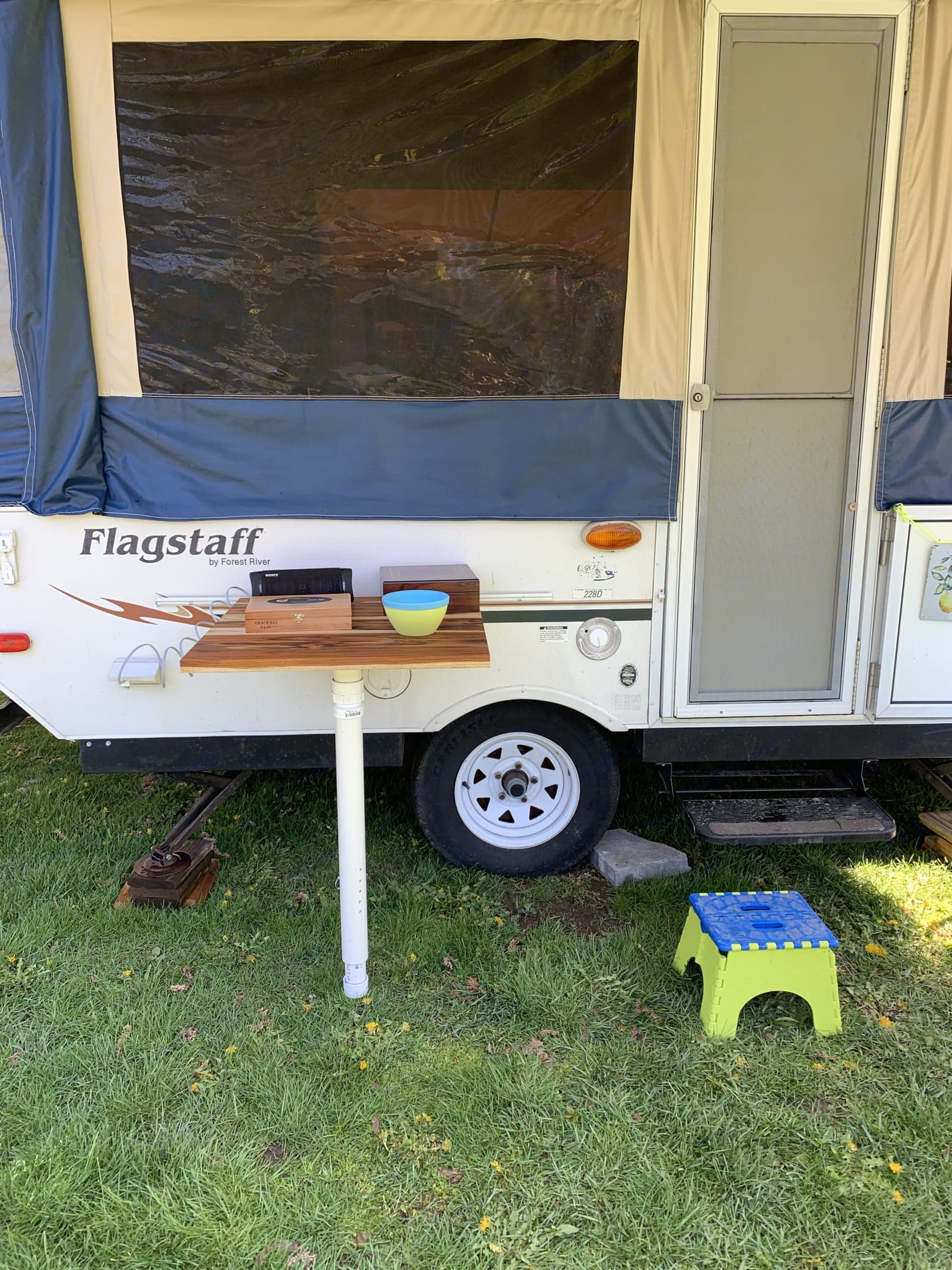 Oiled teak table supports the grill or other accessories.  propane hook up conveniently located underneath.. Flagstaff 228D 2007