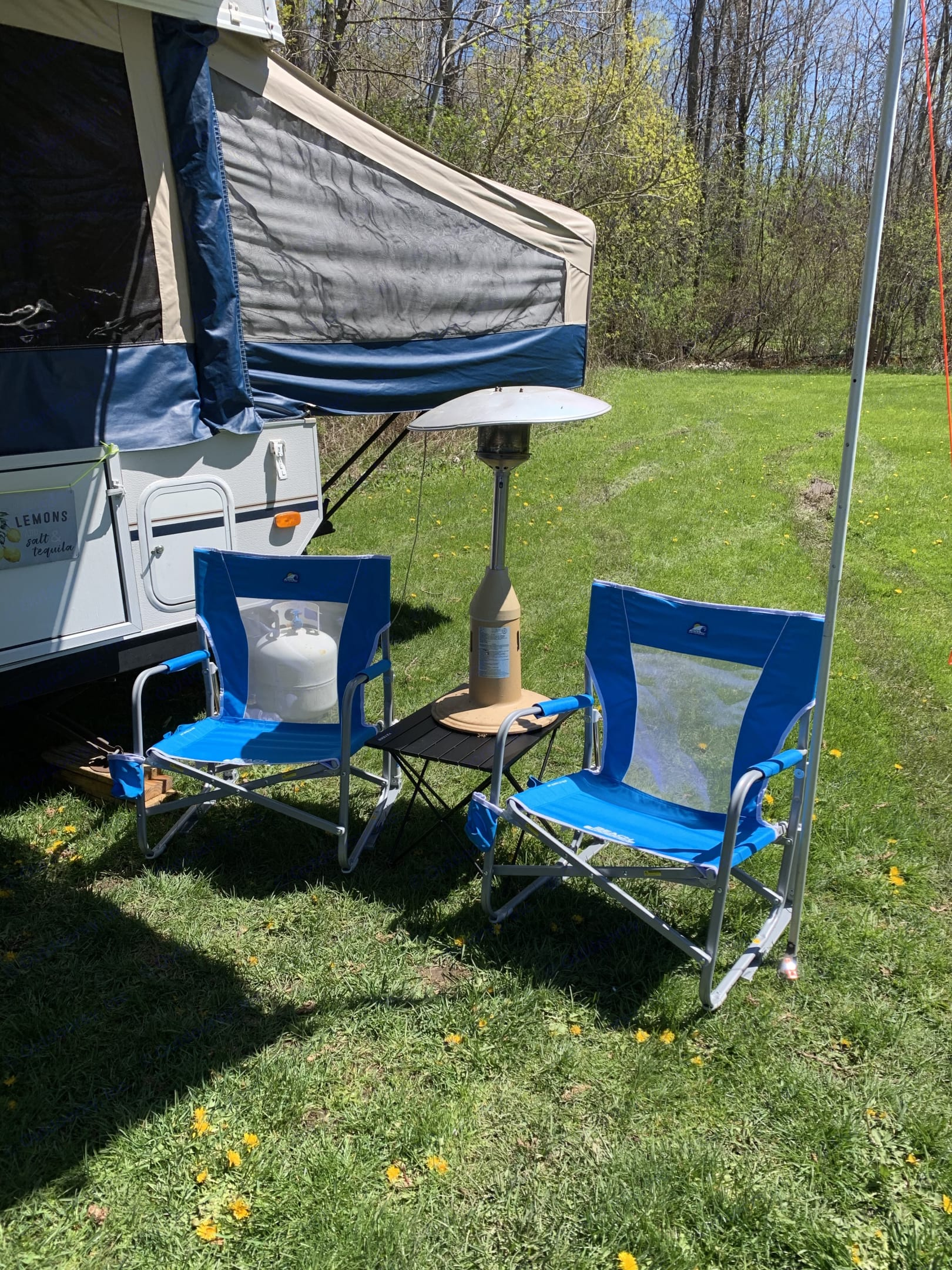 Two sturdy beach rockers and a folding table provide a perfect spot for outdoor relaxing.  The table top heater is available with prior arrangements.. Flagstaff 228D 2007