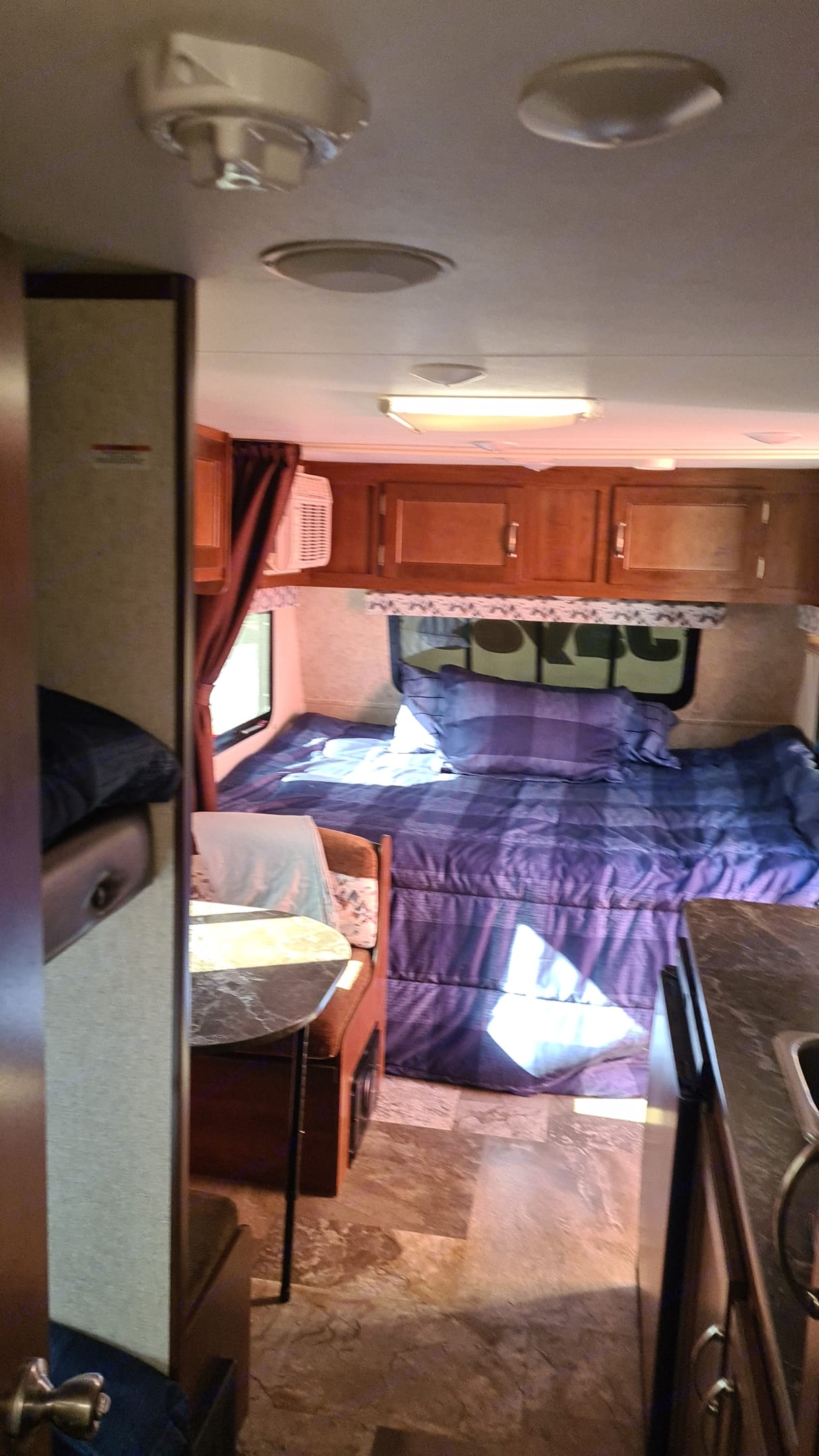 The queen bed moonlights as a bed by night, and a large makeshift couch during the day. . Jayco Jay Flight 2017