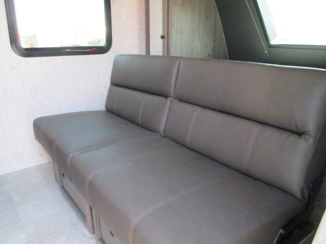 Front queen bed serves both as a sofa and queen bed for maximum seating!. Coachmen Apex 2021